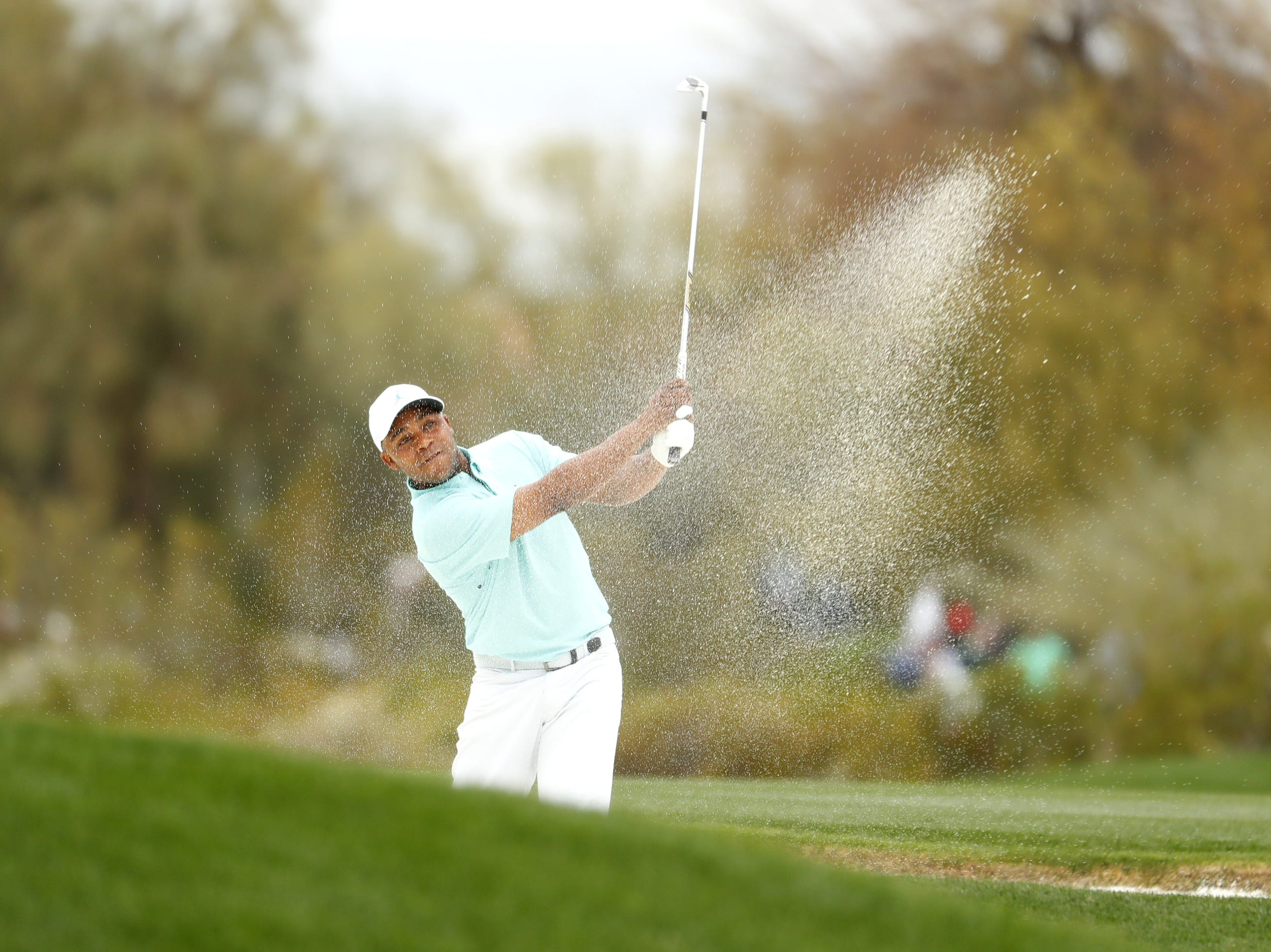 Harold Varner III hits from the fairway bunker on the 2nd hole during the third round of the Waste Management Phoenix Open at TPC Scottsdale in Scottsdale, Ariz. on February 2, 2019.