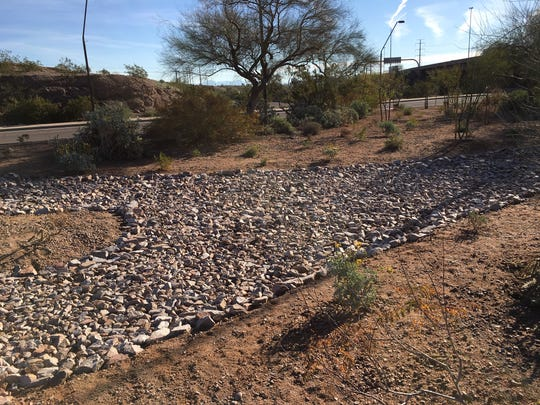 The city of Tempe removed the brick path from the median of Mill Avenue and replaced it with rock landscaping.
