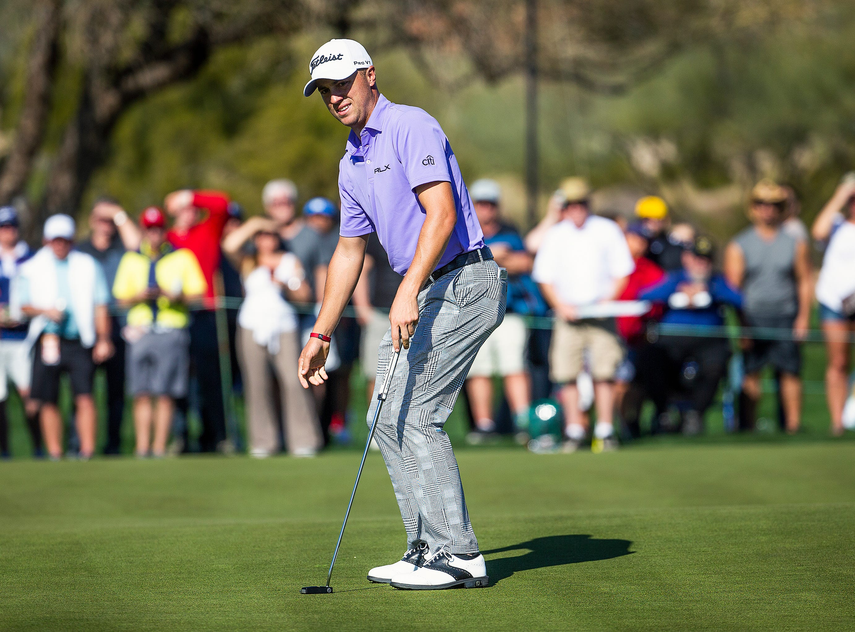 Justin Thomas reacts to missing his putt on the 9th hole during the second round of the Waste Management Phoenix Open at the TPC Scottsdale, Friday, February 1, 2019.