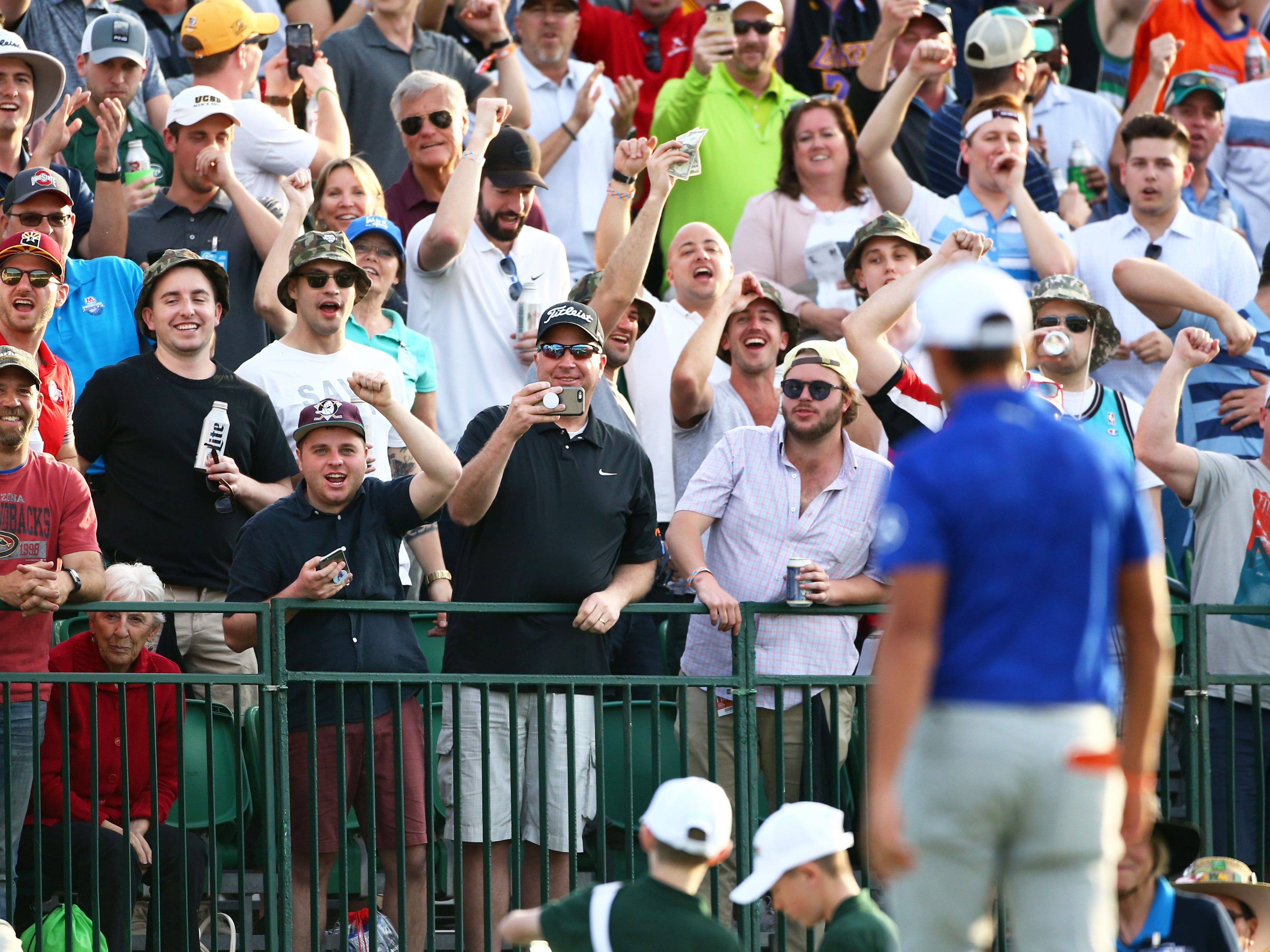 Fans cheer after Rickie Fowler made a birdie on the 16th hole during second round action on Feb. 1 during the Waste Management Phoenix Open at the TPC Scottsdale Stadium Course.