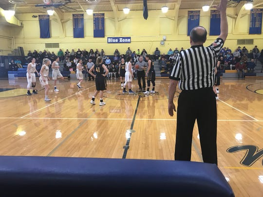 The Elco and Northern Lebanon girls basketball teams prepare for the start of Saturday's game.