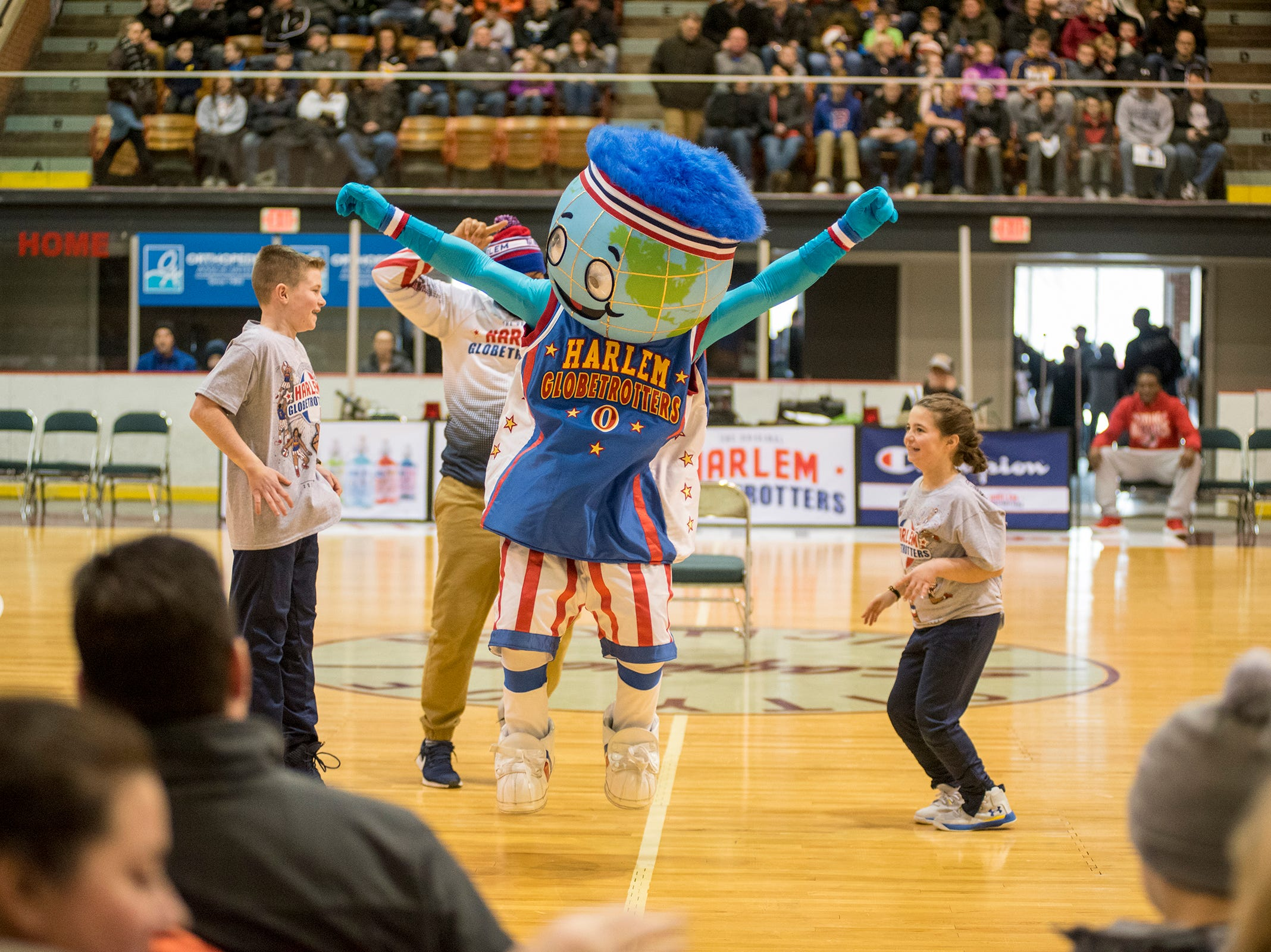 Globie, the mascot for the Harlem Globetrotters, entertains a crowd while they take on the Washington Generals Saturday, Feb. 2, 2019 at McMorran Arena in Port Huron.