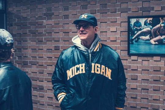 Jim Harbaugh in the hallway at Port Huron Northern High School.