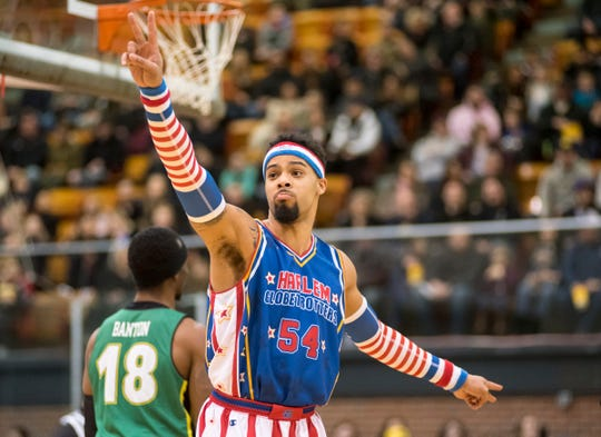Harlem Globetrotters forward Hi-Rise celebrates a point at the start of the Globetrotters' game against the Washington Generals Saturday, Feb. 2, 2019 at McMorran Arena.