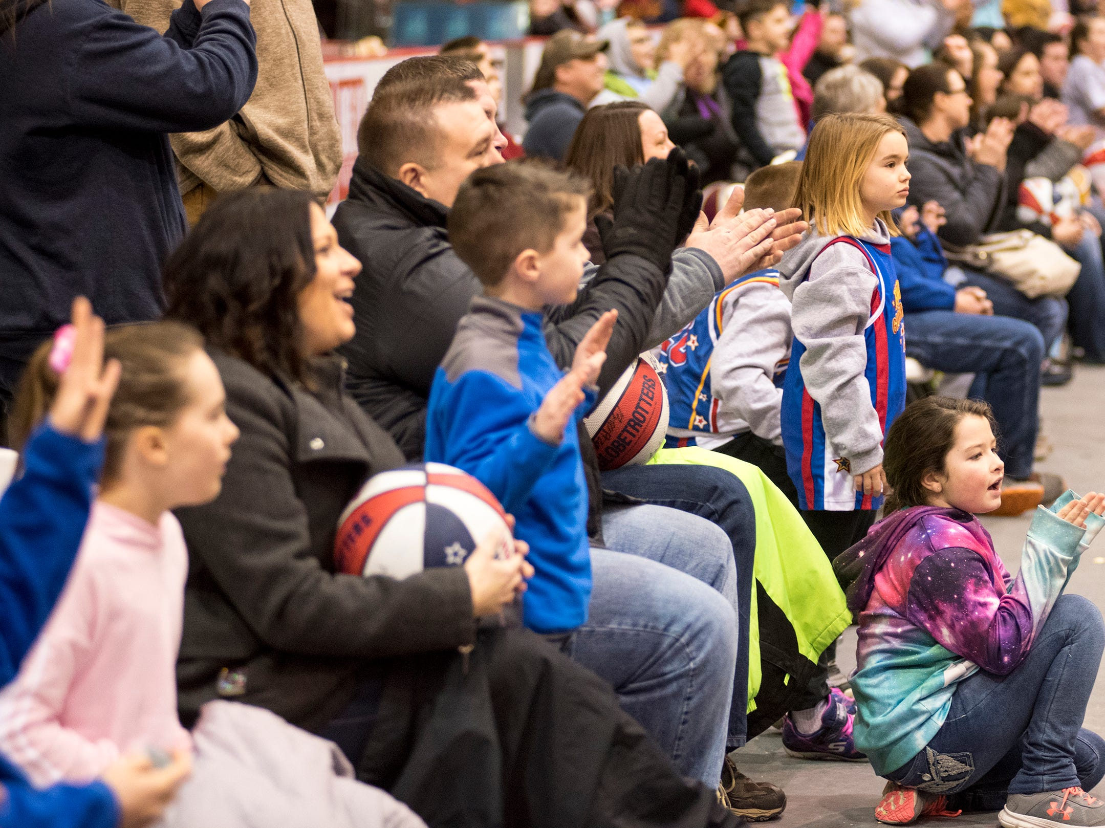 Fans cheer on the Harlem Globetrotters while they take on the Washington Generals Saturday, Feb. 2, 2019 at McMorran Arena in Port Huron.