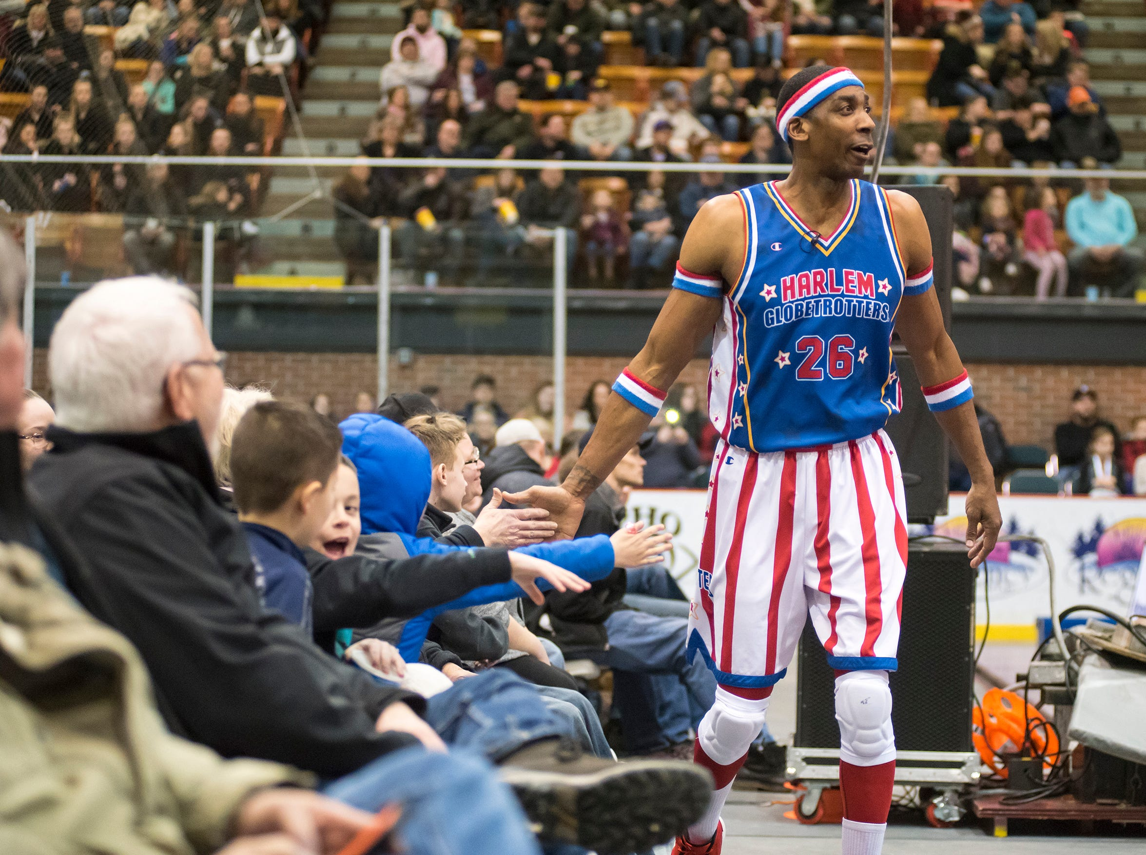 Harlem Globetrotters showman Hi-Lite high-fives fans while they take on the Washington Generals Saturday, Feb. 2, 2019 at McMorran Arena in Port Huron.
