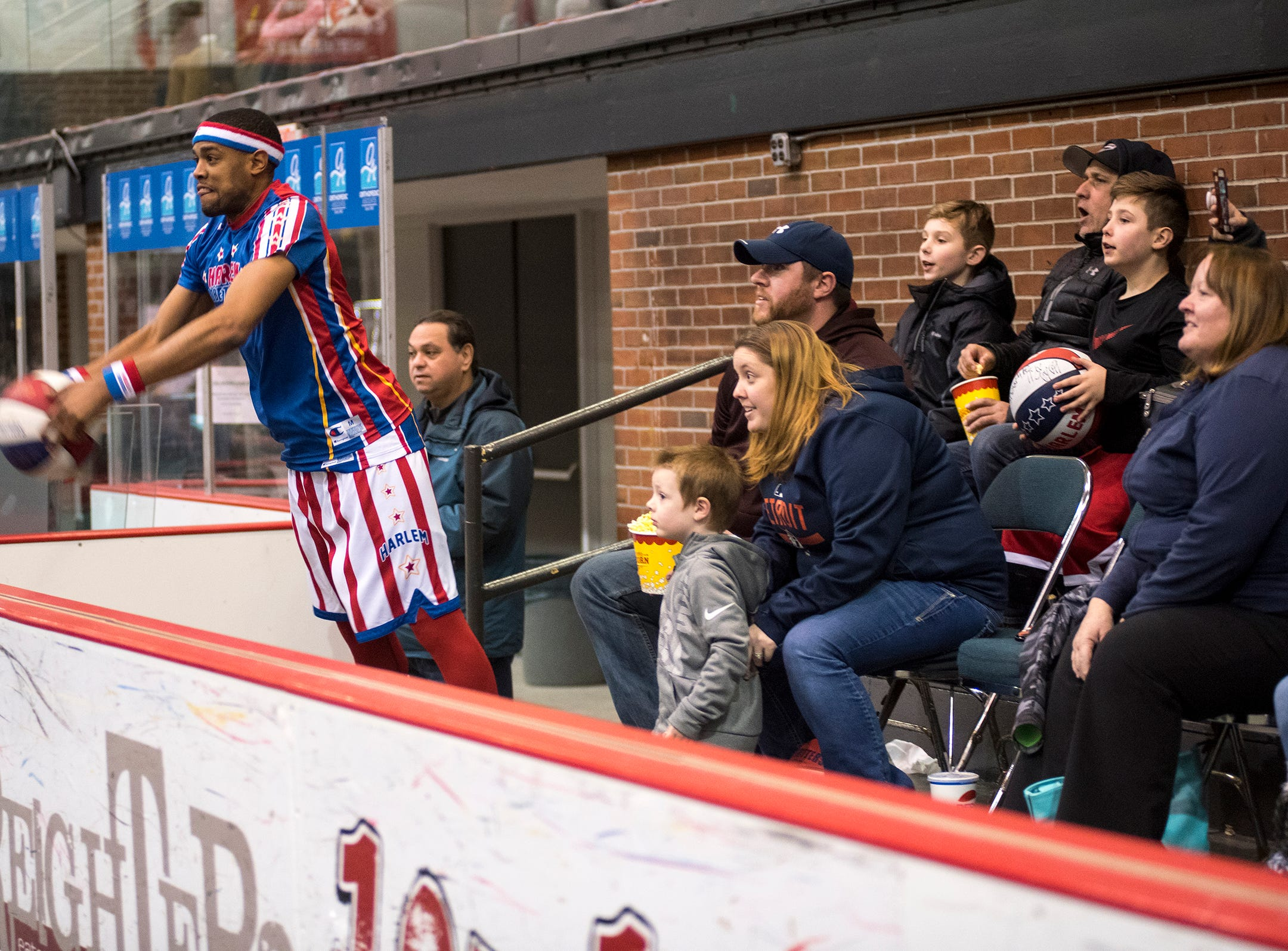 Harlem Globetrotters guard Cheese makes a shot from the audience while warming up before their match against the Washington Generals Saturday, Feb. 2, 2019 at McMorran Arena.