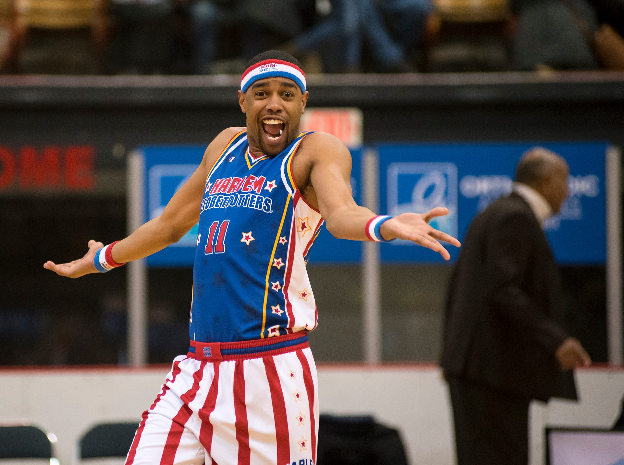 Harlem Globetrotters guard Cheese celebrates a point at the start of the Globetrotters' game against the Washington Generals Saturday, Feb. 2, 2019 at McMorran Arena.