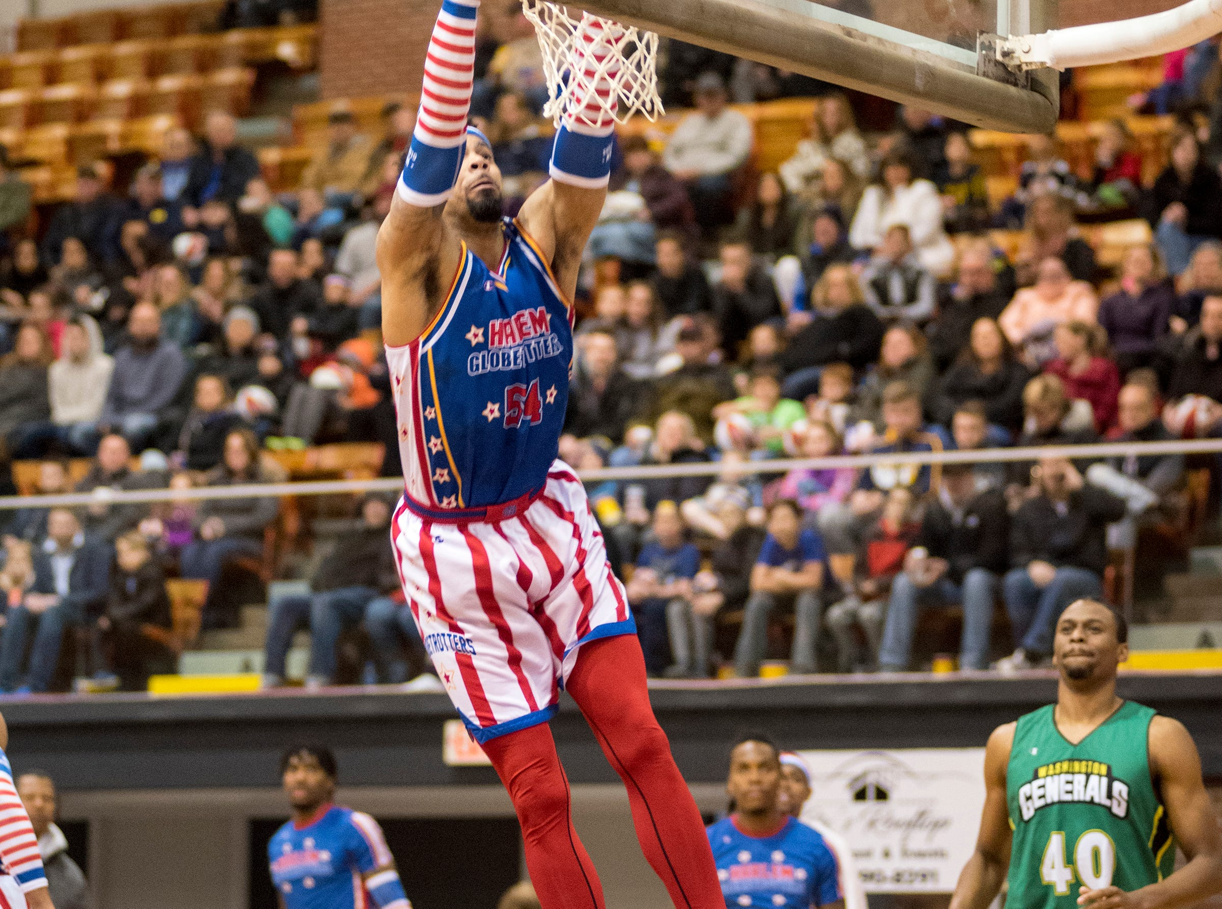 Harlem Globetrotters forward Hi-Rise goes for a dunk while competing against the Washington Generals Saturday, Feb. 2, 2019 at McMorran Arena.