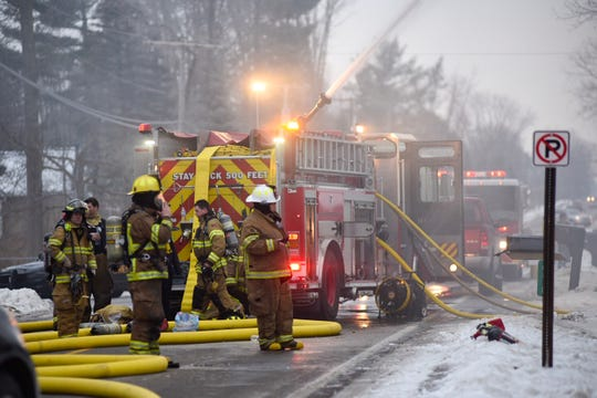 Firefighters from several departments respond to a house fire on West Water Street in Kimball Township Saturday afternoon.