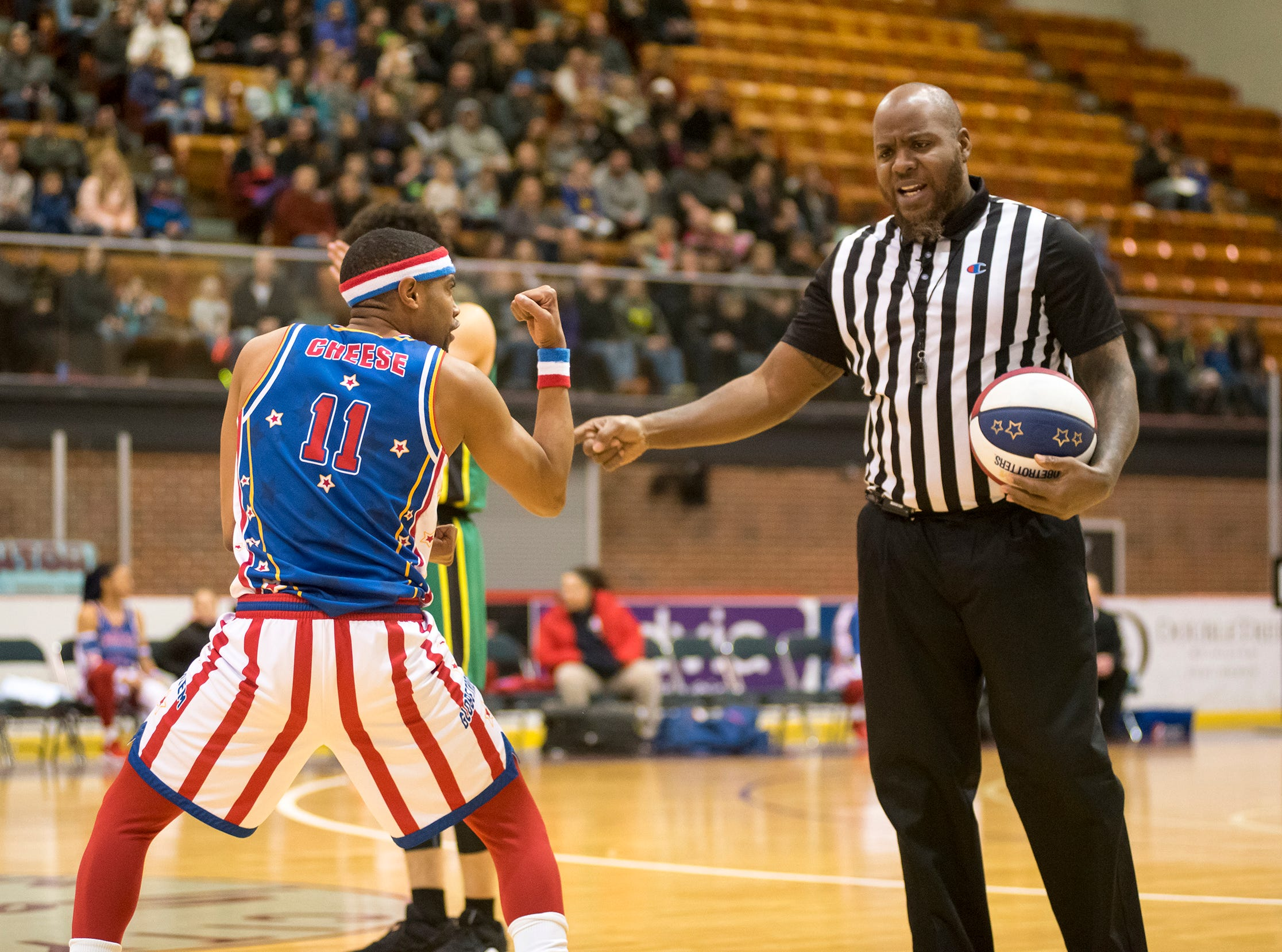 Harlem Globetrotters guard Cheese teases a referree during Globetrotters' game against the Washington Generals Saturday, Feb. 2, 2019 at McMorran Arena.