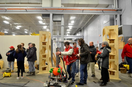 Students brought a robot to try out a new practice field they are building in property provided by PJ Wallbank Springs, on Feb. 1, 2019.