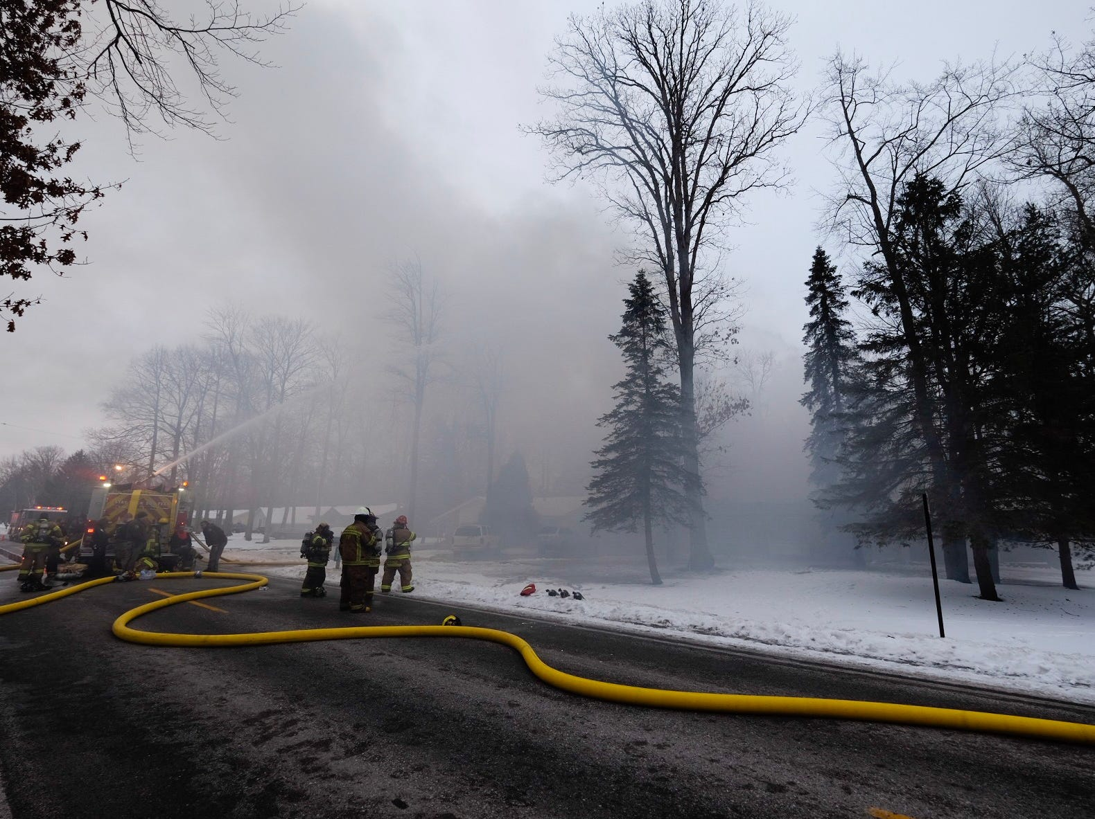 Firefighters work to extinguish a house fire on West Water Street in Kimball Township Saturday, Feb. 2, 2019.