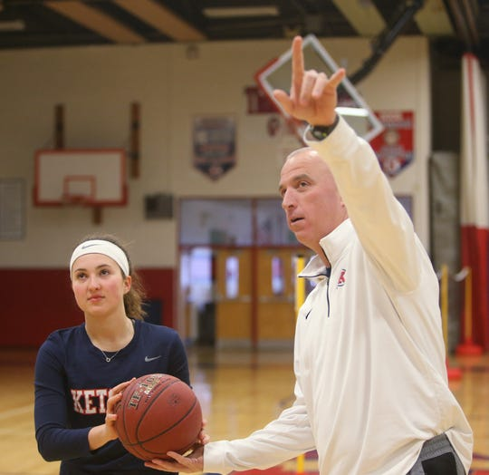 Roy C. Ketcham basketball coach Pat Mealy gives his daughter Abby tips on shooting on January 30, 2019.
