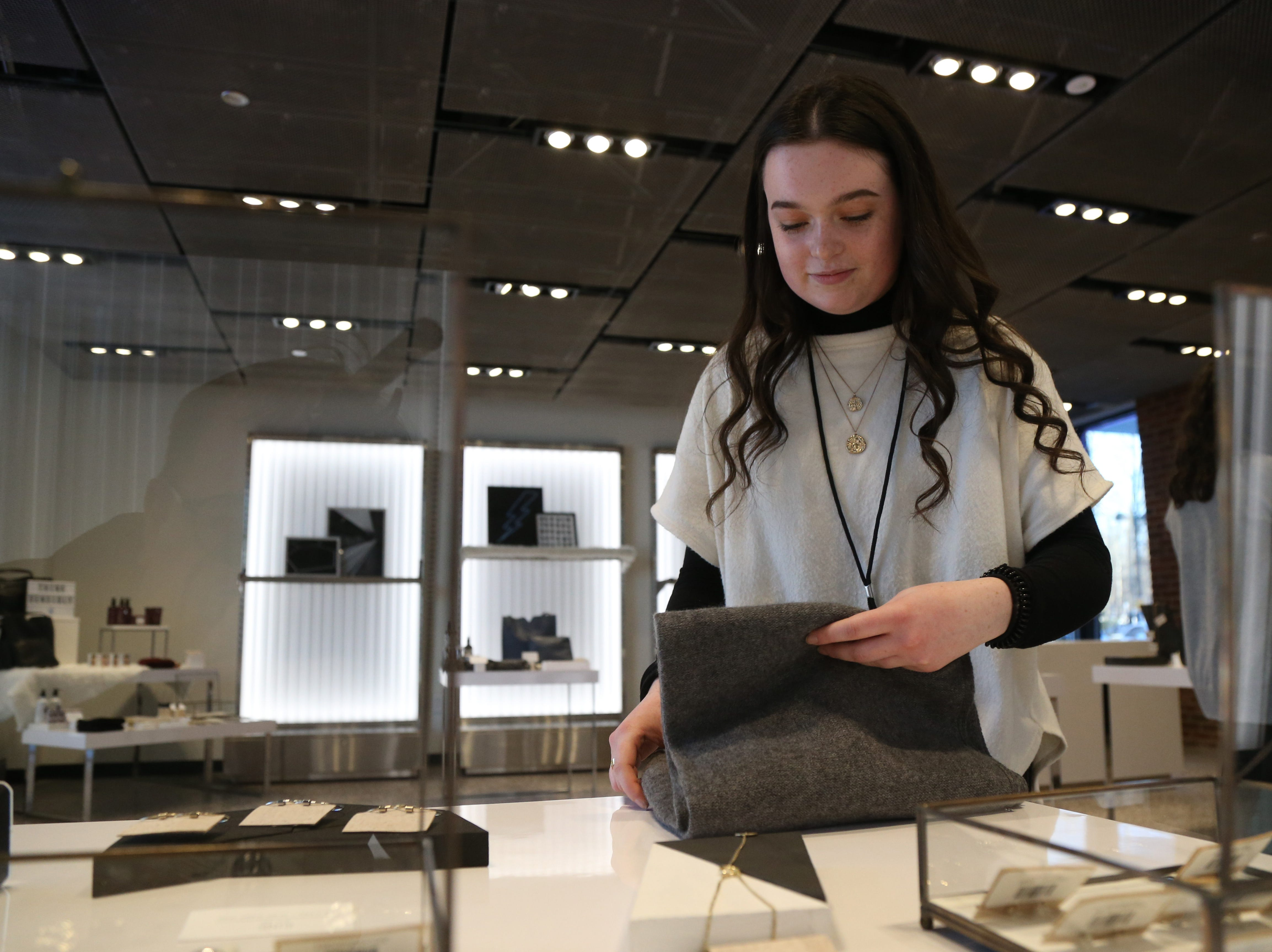 Marist student, Lea Sciancalepore of Albany checks over products for sale at the Mporium, a boutique at Marist College's Steel Plant Studios in Poughkeepsie on February 1, 2019.