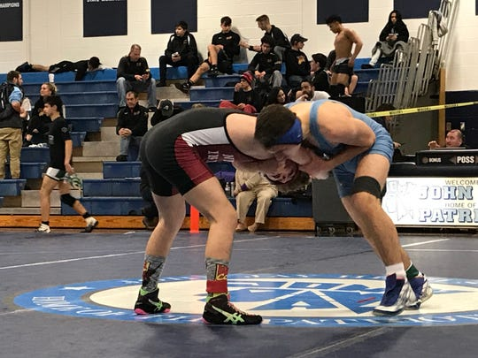 John Barberan wrestles Sam Szerlip of Nyack in the 132-pound finals of the Section 1 qualifiers on Saturday.