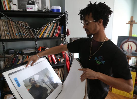 Jeffrey Francis sorts through some of is photographic prints at his home in the City of Poughkeepsie on January 30, 2019.