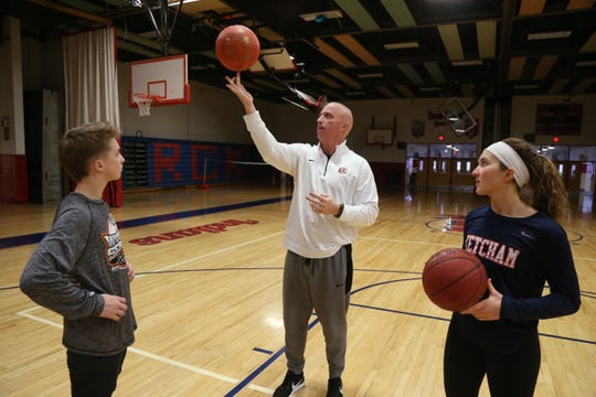 Roy C. Ketcham basketball coach Pat Mealy with his children, from left, Ryan and Abby at Ketcham High School on January 30, 2019.