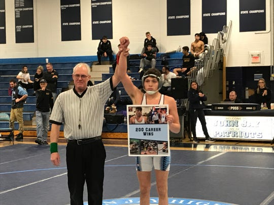 John Jay-East Fishkill's Tyler Albis, after collecting his 200th career victory in February.