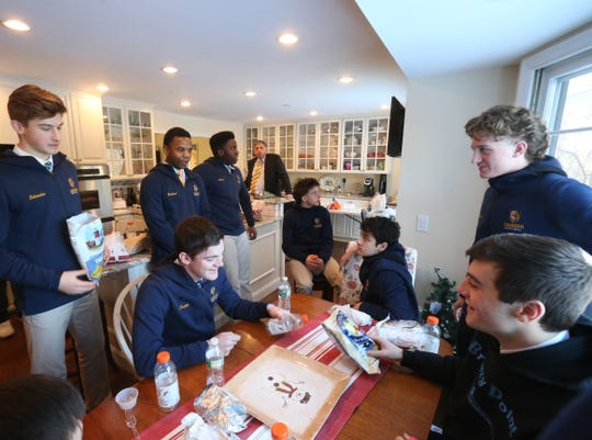Lourdes boys basketball coach Jim Santoro host the team to a pre-game meal at his home in the Town of Poughkeepsie on February 1, 2019.