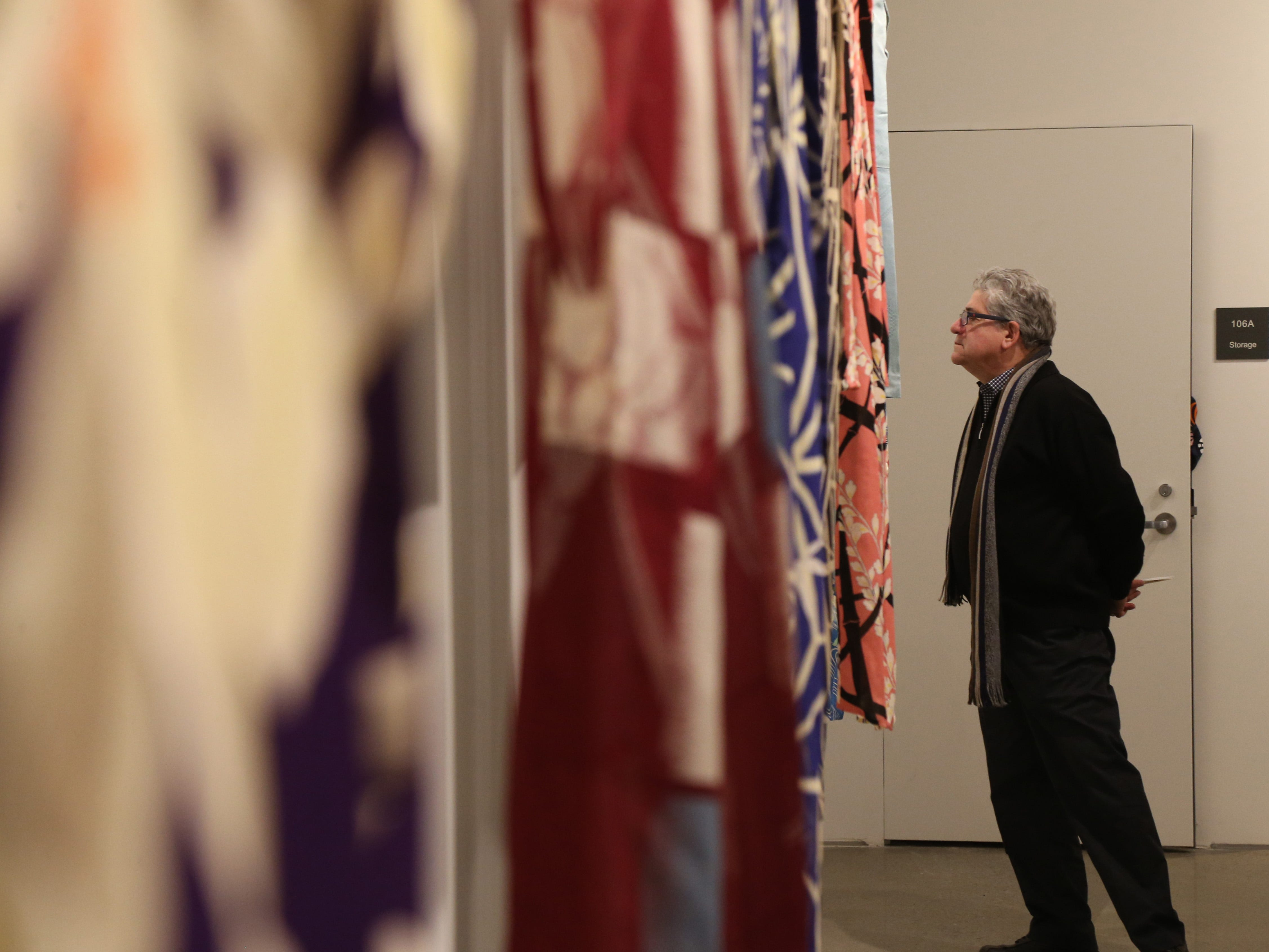 Irving Solero of Clinton inspects some of the Japanese garments & textiles on display in the fashion gallery at Marist College's Steel Plant Studios in Poughkeepsie on February 1, 2019.