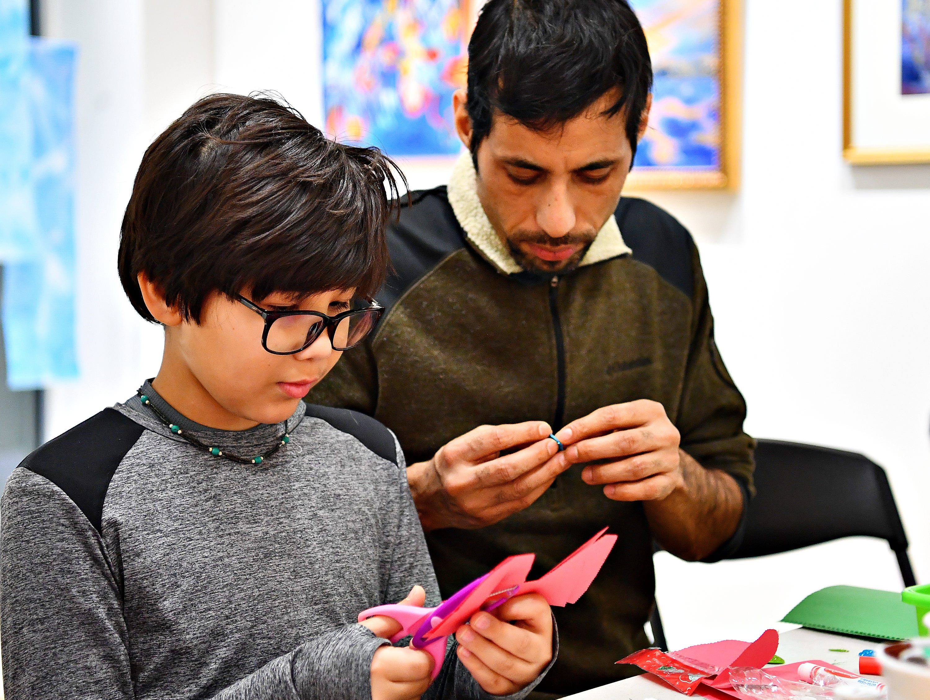 "Abhiyan Budhathoki, 9, left, of Spring Garden Township, and his father Nabaraj Budhathoki, of York City, make valentines to be given to resident at a local senior center during a First Friday Valentine art activity at Creative York in York City, Friday, Feb. 1, 2019. Each person making a Valentine for seniors would receive a 10,000 Acts of Kindness ""Kindness Coin"" which will guarantee the recipient a seat at the table during the Celebration of York's Unity at Penn Park on June 30. Dawn J. Sagert photo"
