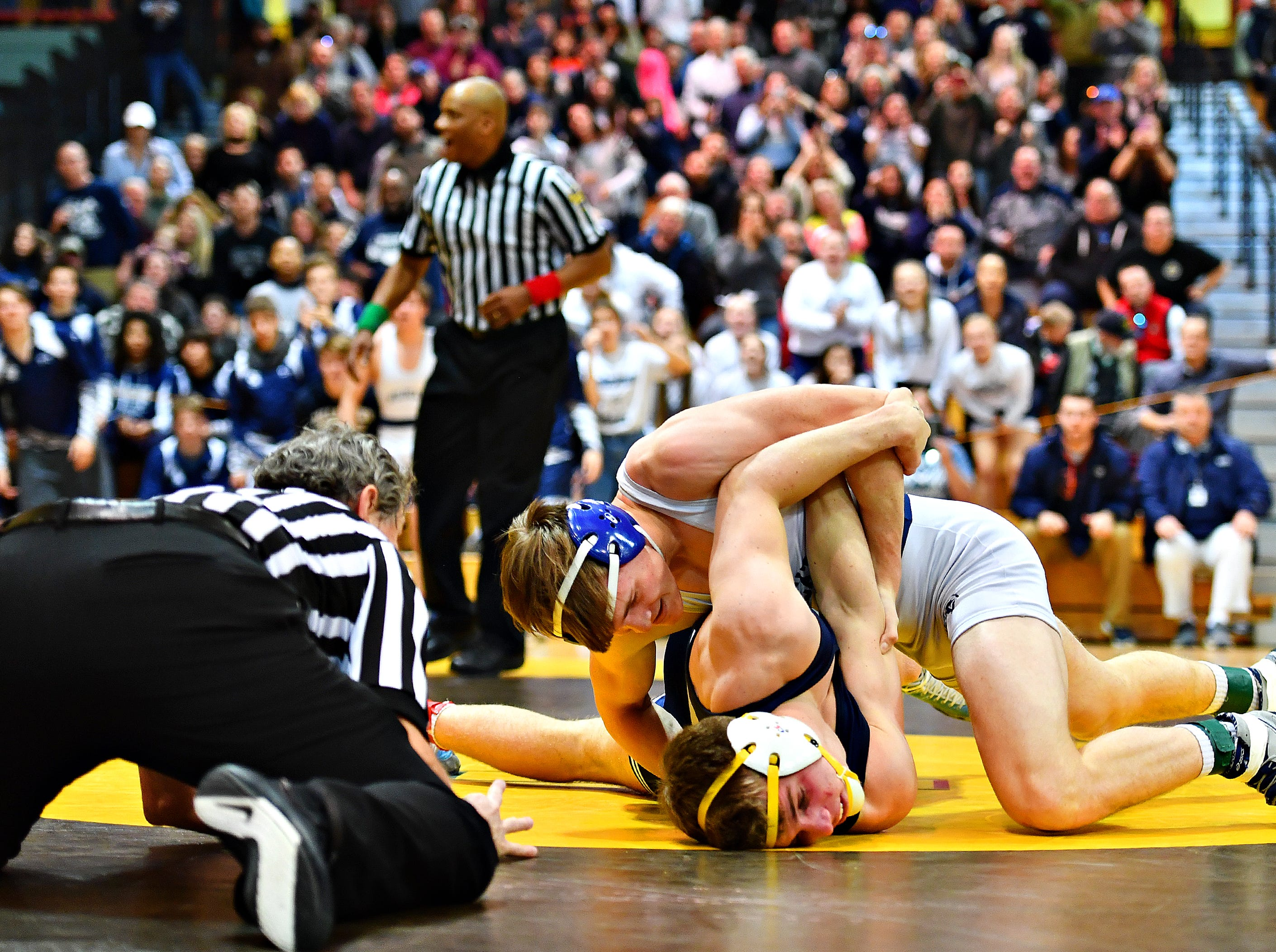 Dallastown's John Ligon, top right, wrestles Cedar Cliff's Bobby Whalen in the 160 pound weight class during District 3, Class 3A wrestling championship action at Milton Hershey High School in Hershey, Saturday, Feb. 2, 2019. Dawn J. Sagert photo