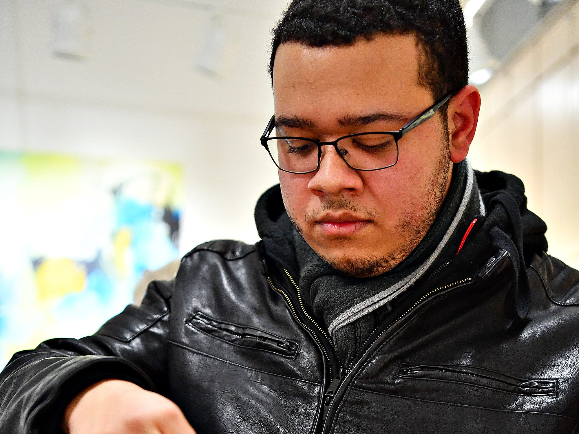 "York College student Marvin Dunmeyer, of Spring Garden Township, makes a Valentine as 10,000 Acts of Kindness hosts a First Friday Valentine art activity at Creative York in York City, Friday, Feb. 1, 2019. Each person making a Valentine for seniors would receive a ""Kindness Coin"" which will guarantee the recipient a seat at the table during the Celebration of York's Unity at Penn Park on June 30. Dawn J. Sagert photo"