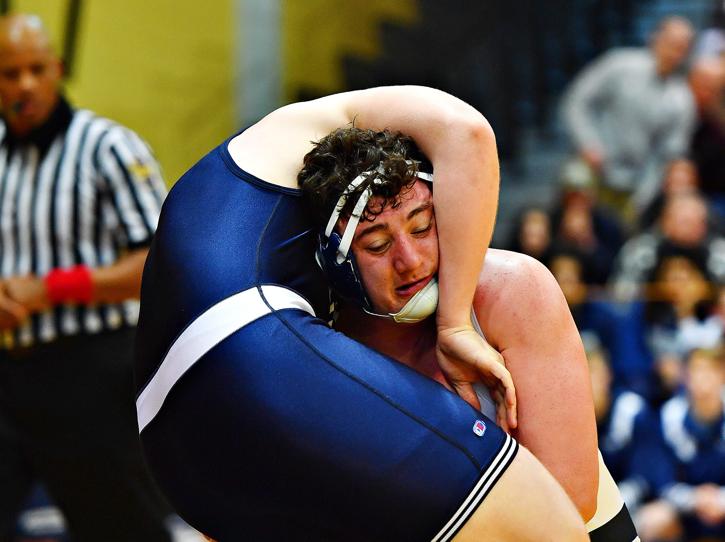 Dallastown's Raymond Christas, back, wrestles Cedar Cliff's Anthony Shires in the 285 pound weight class during District 3, Class 3A wrestling championship action at Milton Hershey High School in Hershey, Saturday, Feb. 2, 2019. Dawn J. Sagert photo