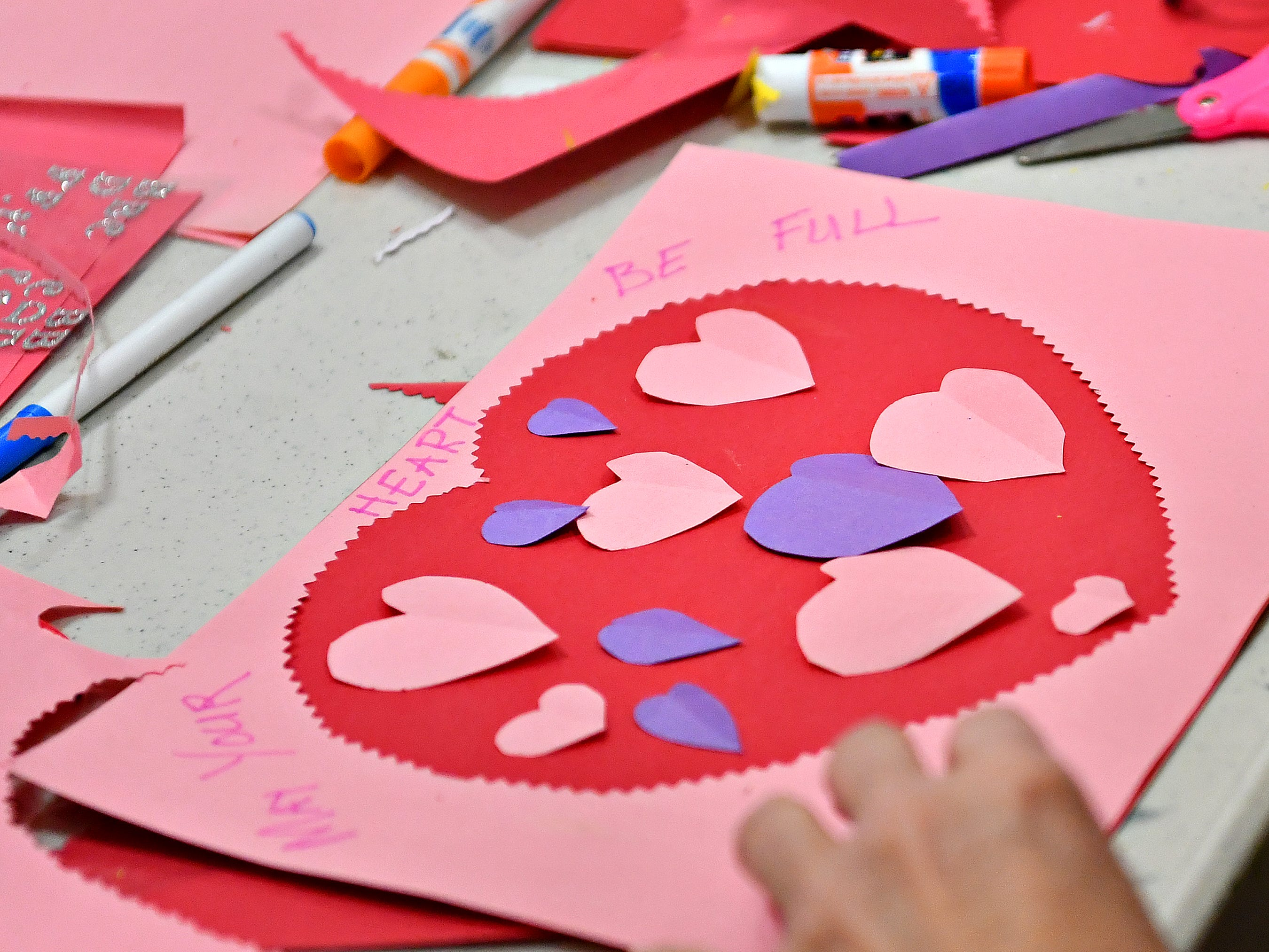 "10,000 Acts of Kindness hosts a First Friday Valentine art activity at Creative York in York City, Friday, Feb. 1, 2019. Each person making a Valentine for seniors would receive a ""Kindness Coin"" which will guarantee the recipient a seat at the table during the Celebration of York's Unity at Penn Park on June 30. Dawn J. Sagert photo"