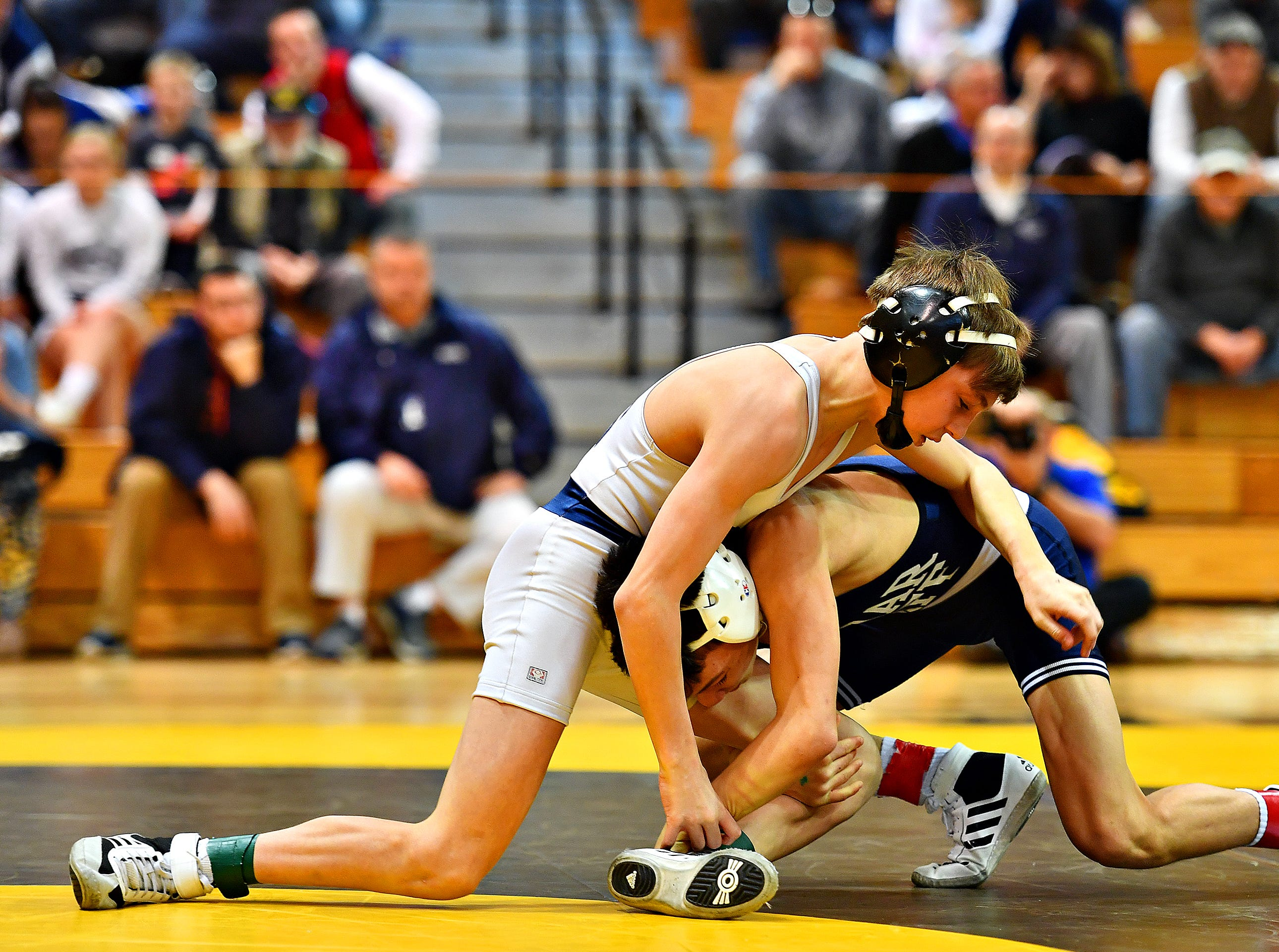 Dallastown's Caden Dobbins, left, wrestles Cedar Cliff's Aiden Lewis in the 106 pound weight class during District 3, Class 3A wrestling championship action at Milton Hershey High School in Hershey, Saturday, Feb. 2, 2019. Dawn J. Sagert photo