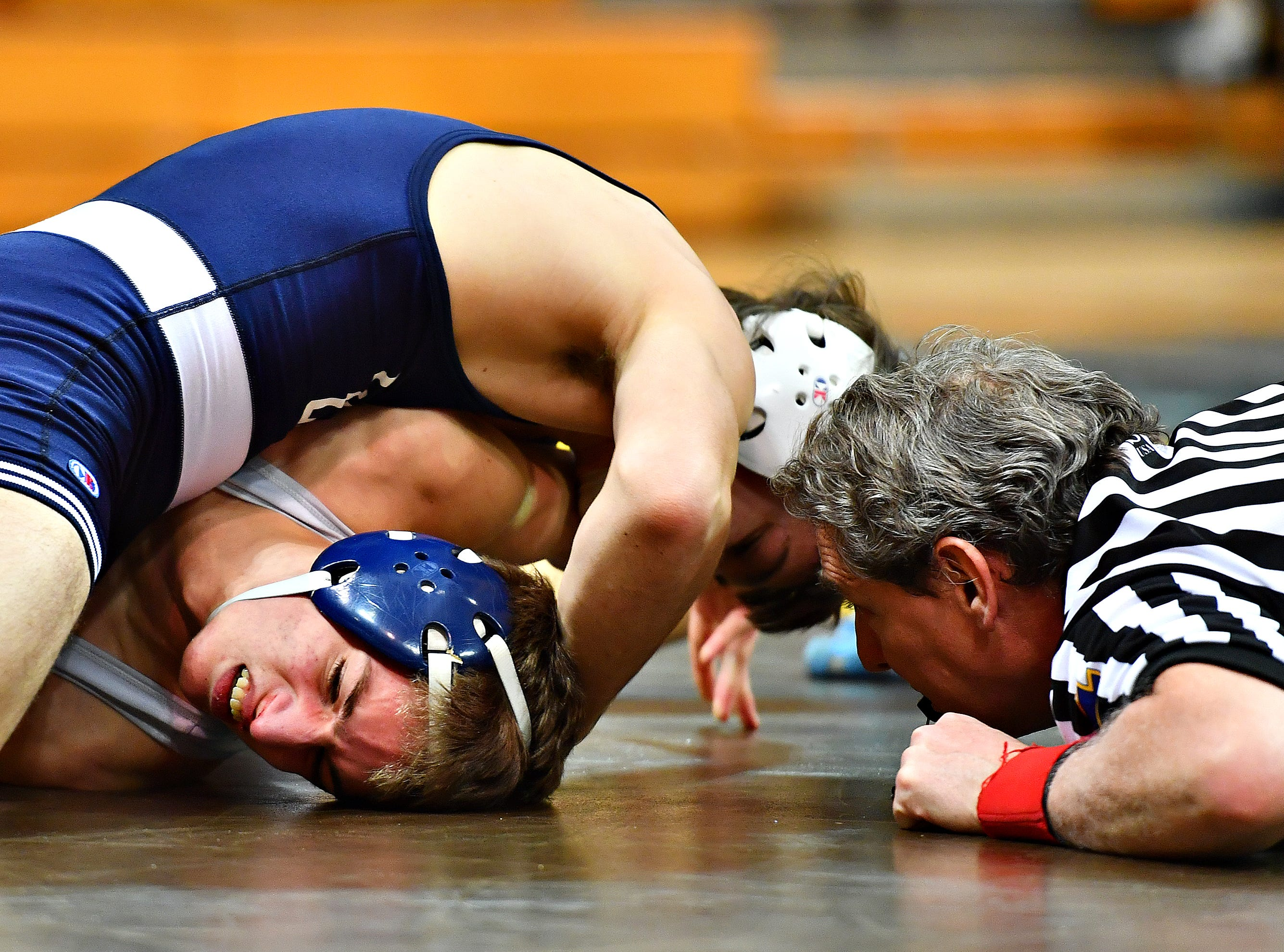 Dallastown's Carter MacDonald, lower left, wrestles Cedar Cliff's Creed Bogardus in the 120 pound weight class during District 3, Class 3A wrestling championship action at Milton Hershey High School in Hershey, Saturday, Feb. 2, 2019. Dawn J. Sagert photo