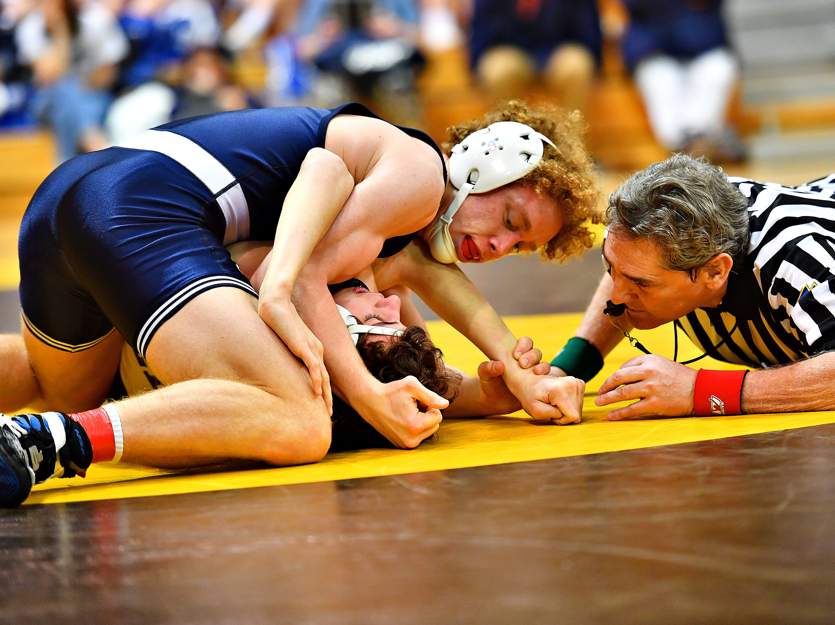 Dallastown's Cael Turnbull, left, wrestles Cedar Cliff's Mike Cassidy in the 132 pound weight class during District 3, Class 3A wrestling championship action at Milton Hershey High School in Hershey, Saturday, Feb. 2, 2019. Dawn J. Sagert photo
