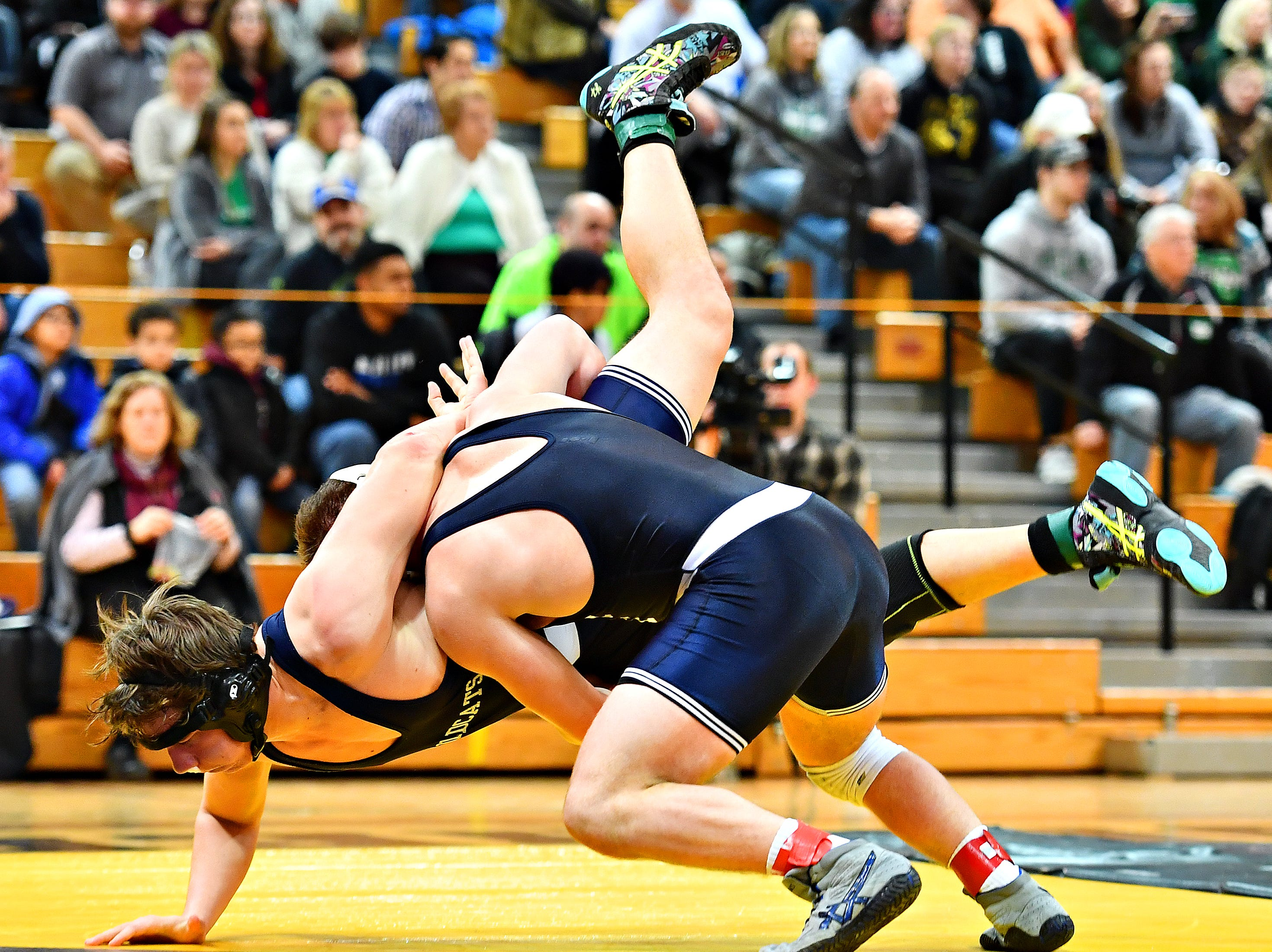 Dallastown's Andrew Smith, left, wrestles Cedar Cliff's Donovan Ball in the 195 pound weight class during District 3, Class 3A wrestling championship action at Milton Hershey High School in Hershey, Saturday, Feb. 2, 2019. Dawn J. Sagert photo