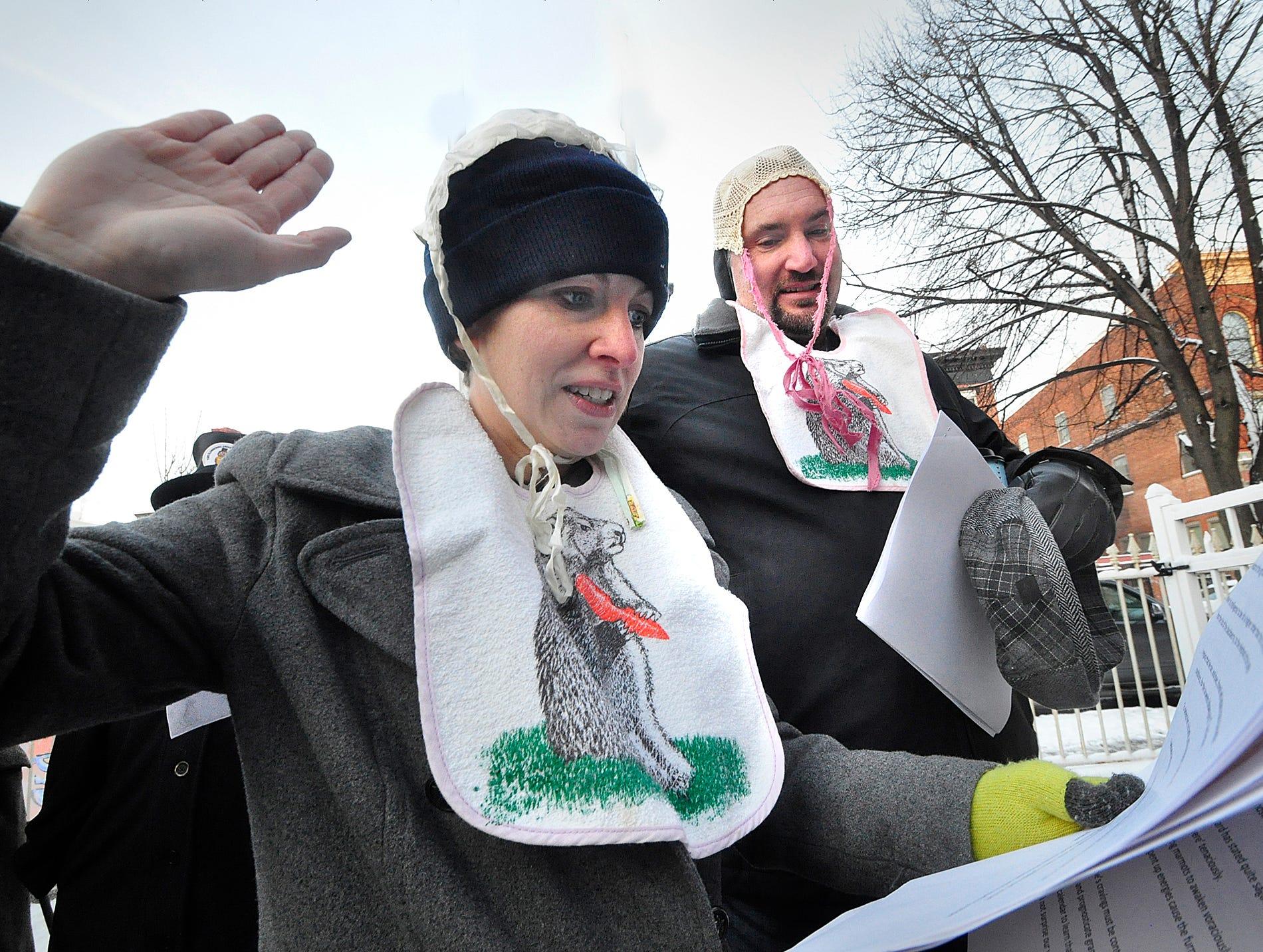 Laura Jensen of York city and Charlie Jansen of York Township read the Groundhog pledge during festivities Saturday.  Bil Bowden photo.