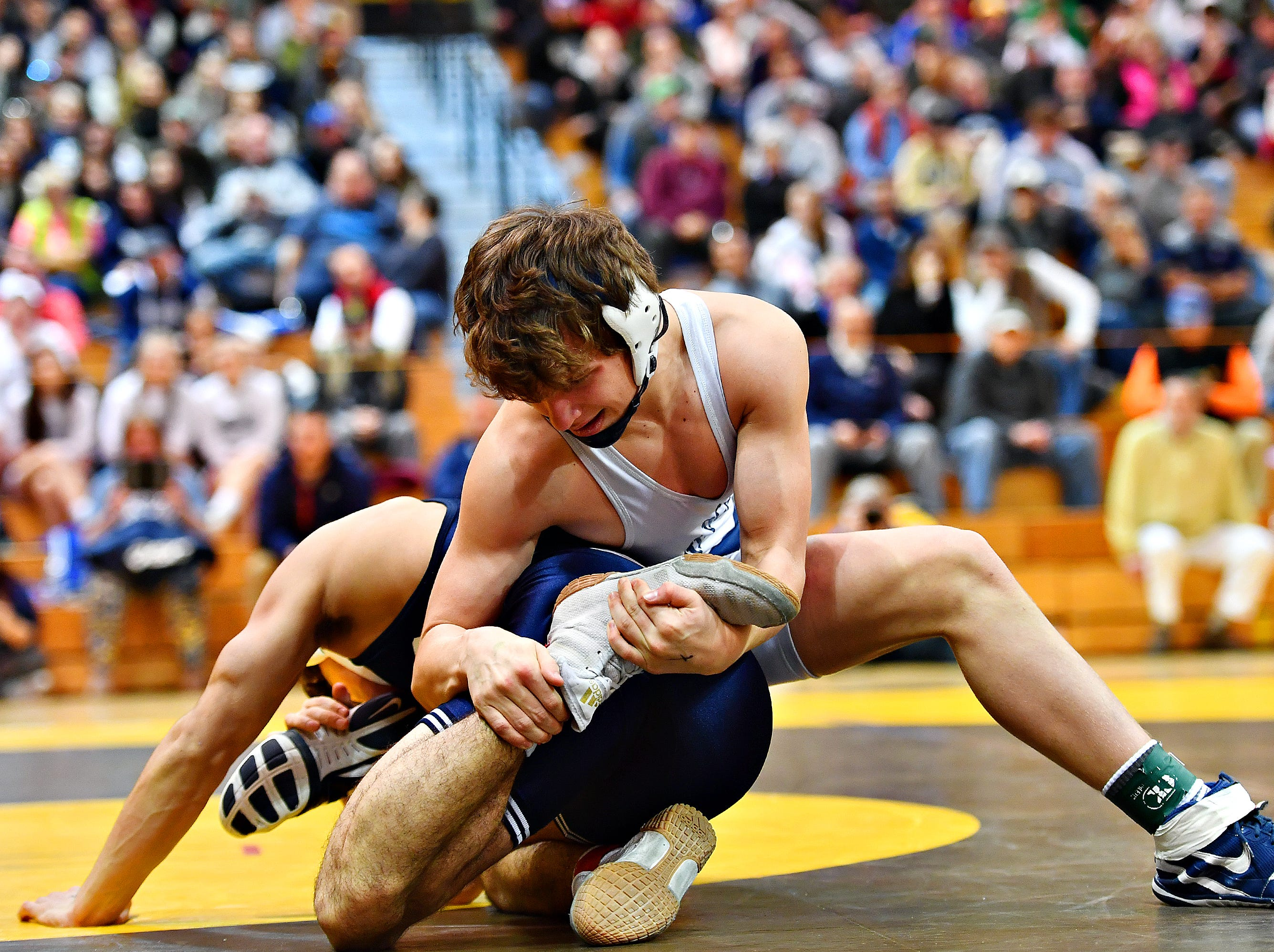 Dallastown's Brooks Gable, right, wrestles Cedar Cliff's Christian Prestil in the 138 pound weight class during District 3, Class 3A wrestling championship action at Milton Hershey High School in Hershey, Saturday, Feb. 2, 2019. Dawn J. Sagert photo
