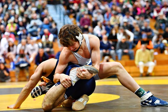 Dallastown's Brooks Gable, right, wrestles Cedar Cliff's Christian Prestil in the 138-pound weight class during the District 3 Class 3-A Wrestling Championship at the Milton Hershey School in February. Gable returns for the Wildcats after a 27-22 season in 2018-2019. Dawn J. Sagert photo