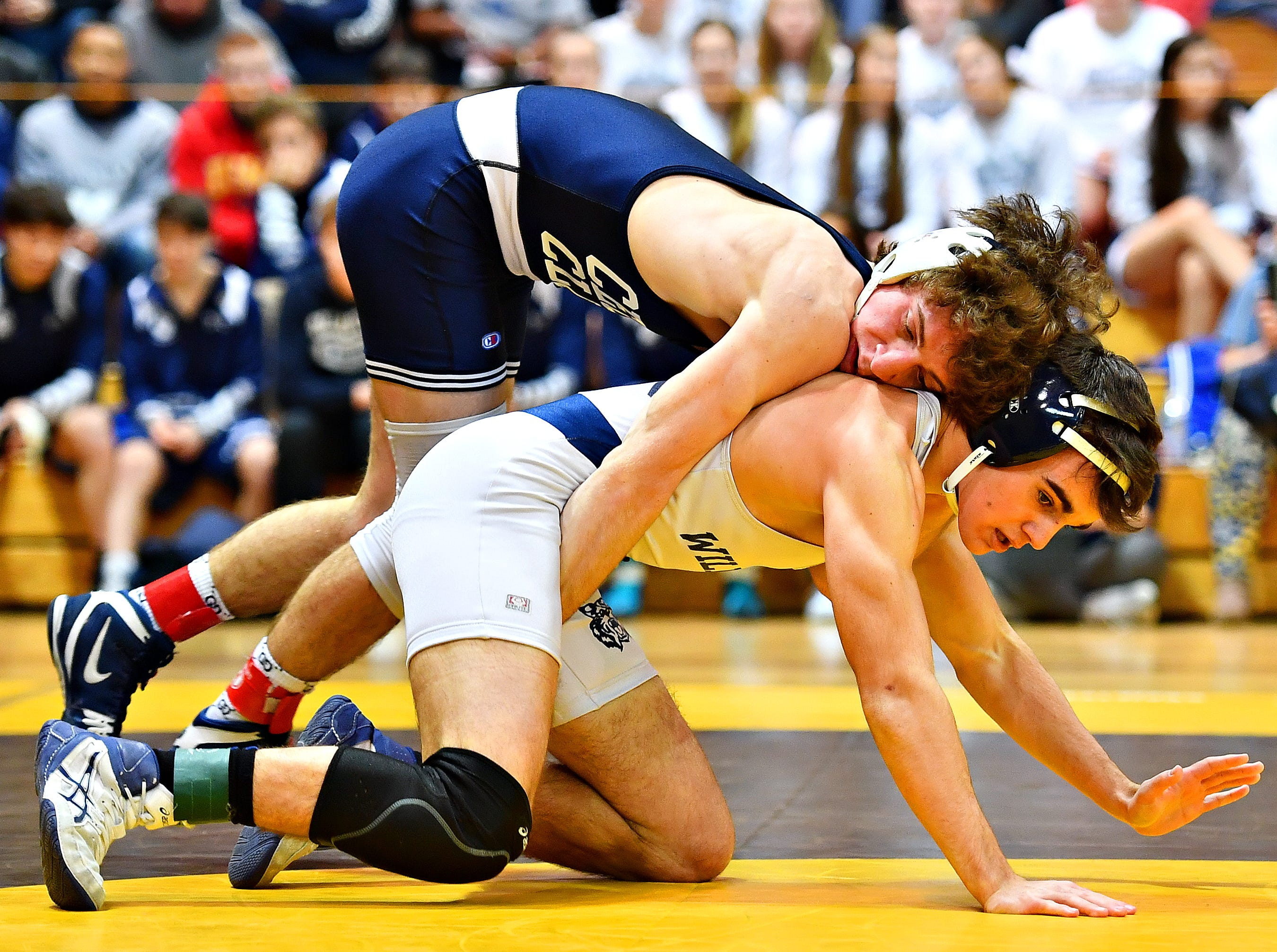 Cedar Cliff's JJ Wilson wrestles Dallastown's Donovan Trauger in the 126 pound weight class during District 3, Class 3A wrestling championship action at Milton Hershey High School in Hershey, Saturday, Feb. 2, 2019. Dawn J. Sagert photo