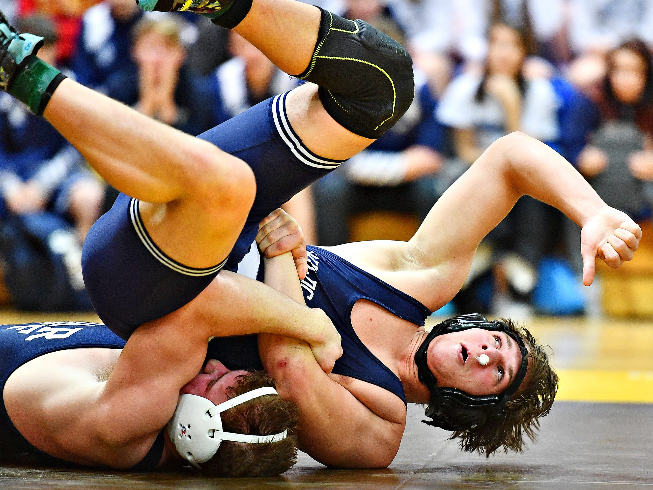 Dallastown's Andrew Smith, top, wrestles Cedar Cliff's Donovan Ball in the 195 pound weight class during District 3, Class 3A wrestling championship action at Milton Hershey High School in Hershey, Saturday, Feb. 2, 2019. Dawn J. Sagert photo