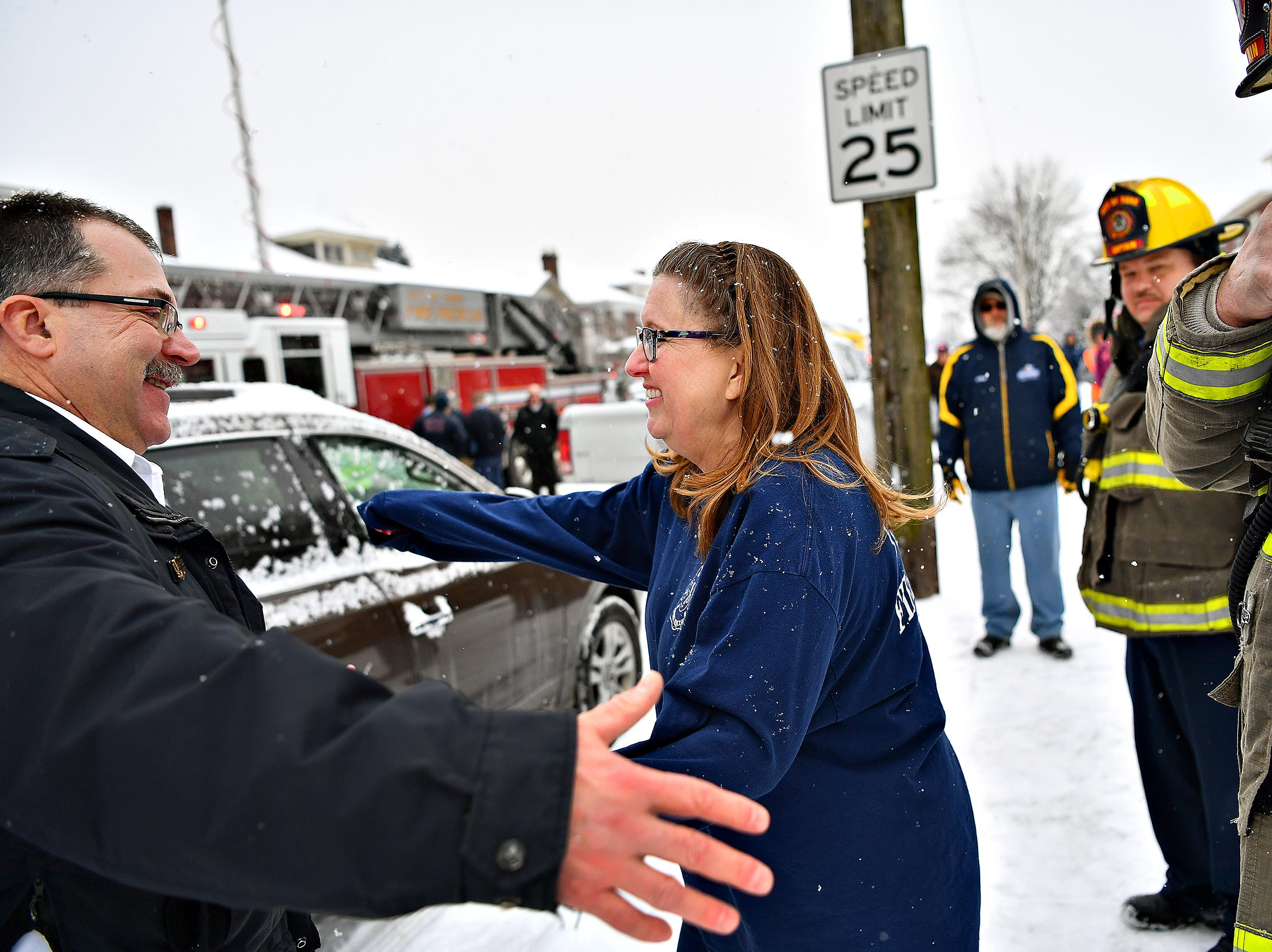 Newly retired York City Fire Chief David Michaels, left, is greeted by his wife, Barb Michaels, upon his arrival home following his final shift in York City, Friday, Feb. 1, 2019. Michaels has been chief since 2012, and has been with York City Department of Fire & Rescue for 28 years. Dawn J. Sagert photo
