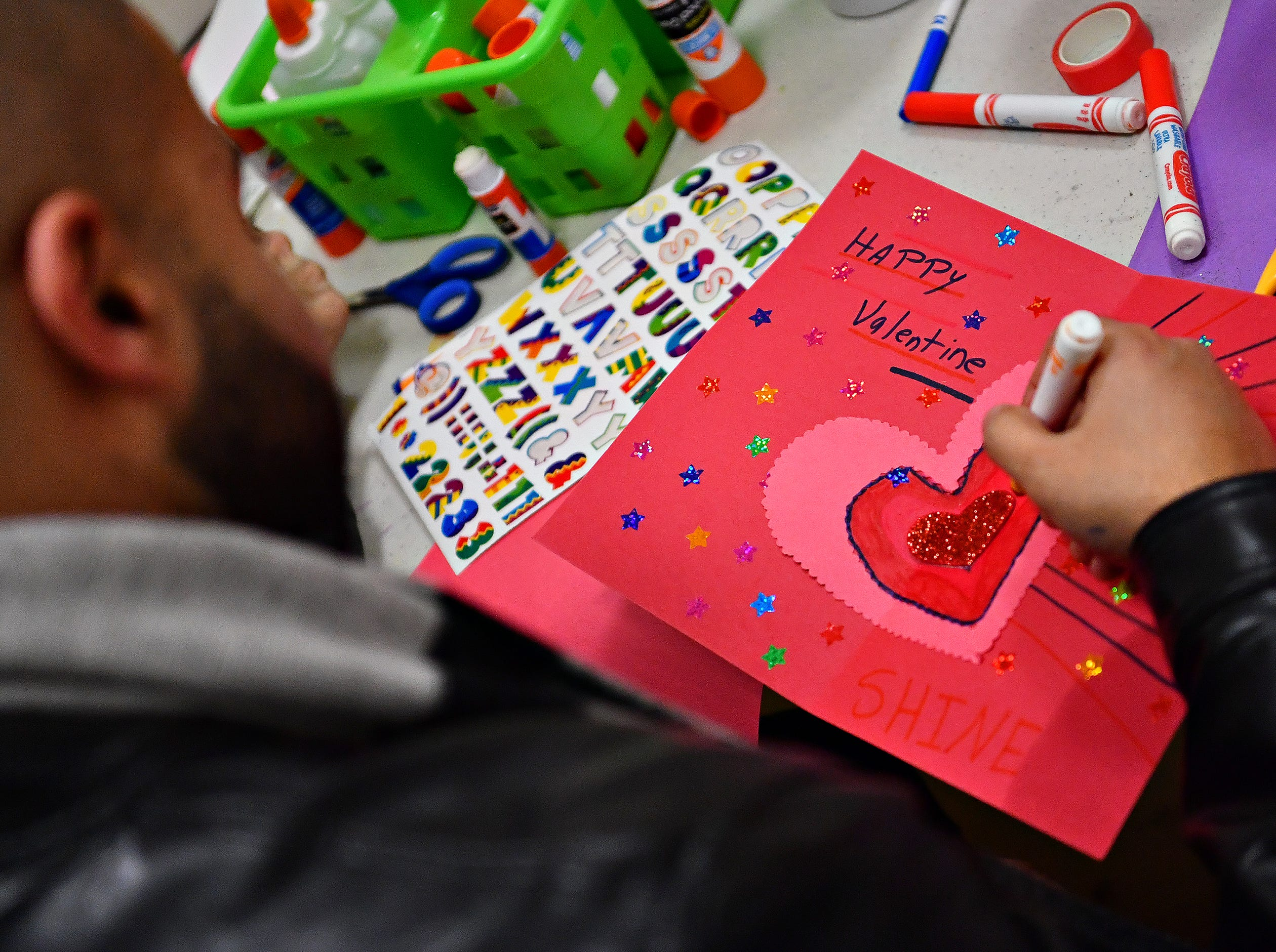 "Peter Bottros, of Springettsbury Township, makes a Valentine as 10,000 Acts of Kindness hosts a First Friday Valentine art activity at Creative York in York City, Friday, Feb. 1, 2019. Each person making a Valentine for seniors would receive a ""Kindness Coin"" which will guarantee the recipient a seat at the table during the Celebration of York's Unity at Penn Park on June 30. Dawn J. Sagert photo"