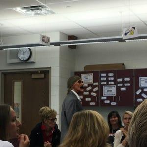 "Friendship Elementary School Principal Lisa Boyer dons blackface as Steve Harvey in staff game of ""Family Feud"" in August 2018."