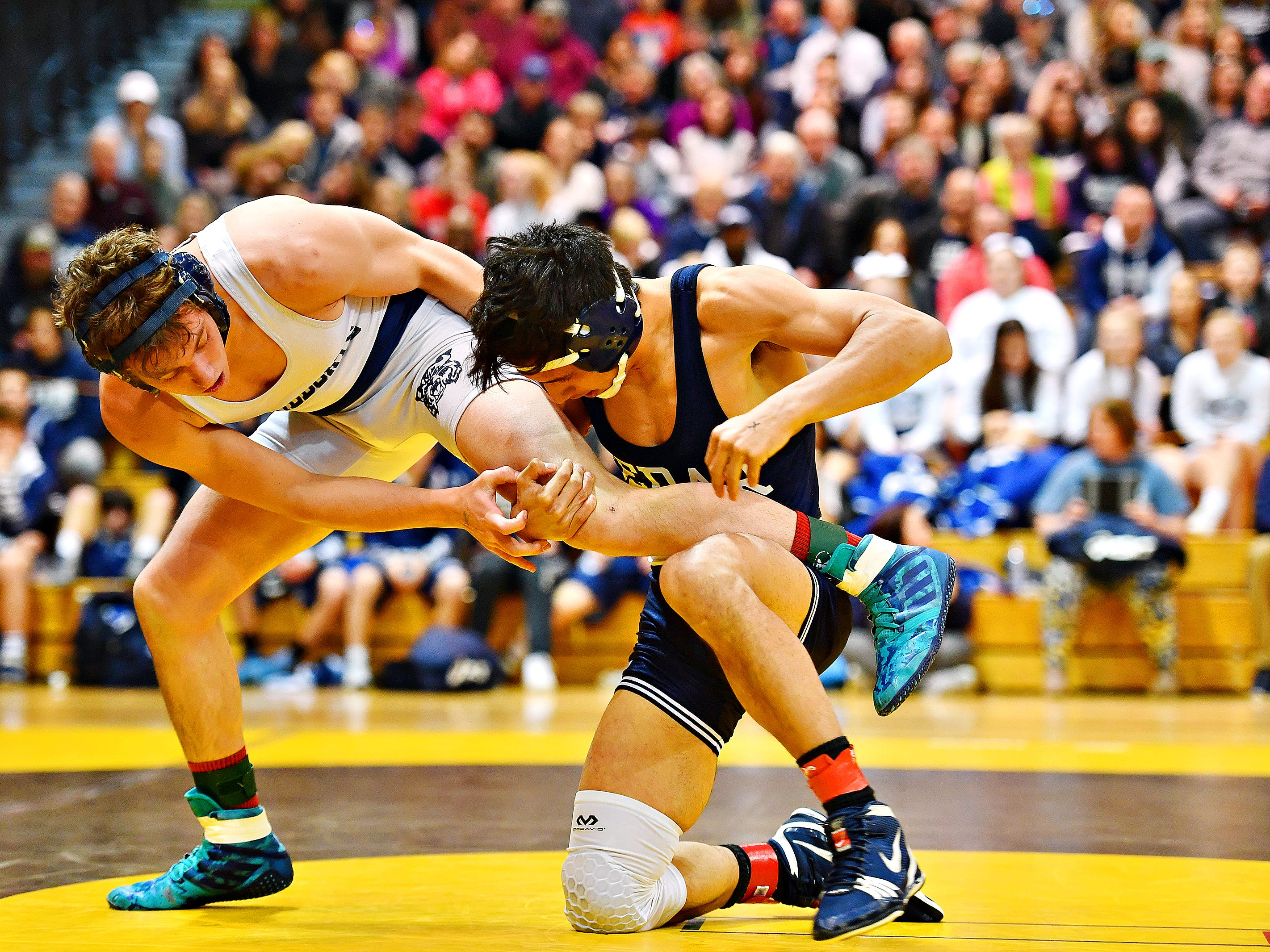 Dallastown's Hunter Sweitzer, left, wrestles Cedar Cliff's Danny Zigue in the 152 pound weight class during District 3, Class 3A wrestling championship action at Milton Hershey High School in Hershey, Saturday, Feb. 2, 2019. Dawn J. Sagert photo
