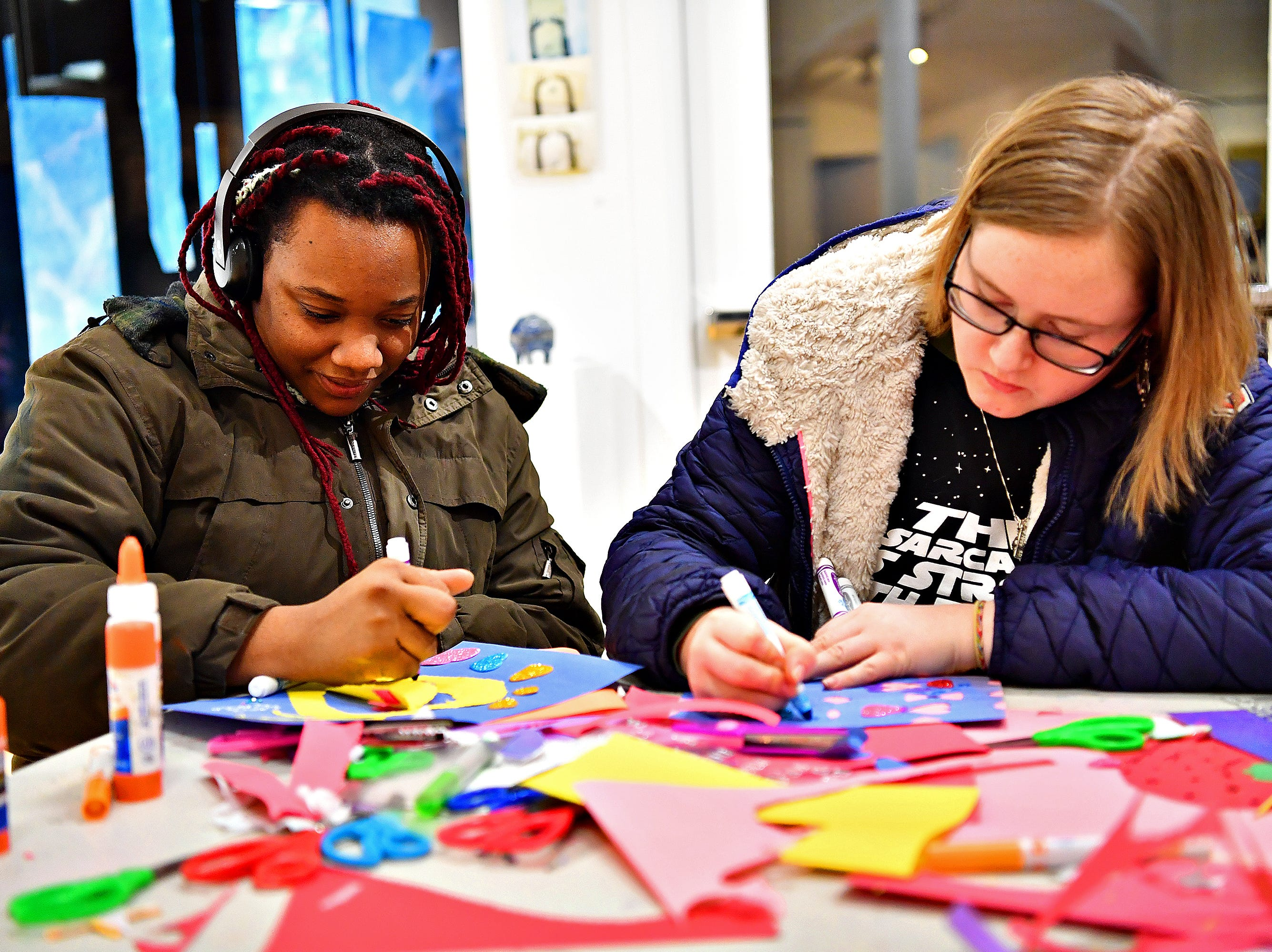 "Lexus Gore, of York City, left, and York College student Kaitlyn Hopkins, of Spring Garden Township, make Valentines as 10,000 Acts of Kindness hosts a First Friday Valentine art activity at Creative York in York City, Friday, Feb. 1, 2019. Each person making a Valentine for seniors would receive a ""Kindness Coin"" which will guarantee the recipient a seat at the table during the Celebration of York's Unity at Penn Park on June 30. Dawn J. Sagert photo"