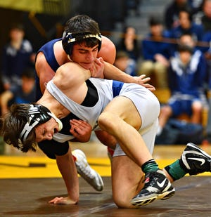 Dallastown's Franklin Klinger, front, wrestles Cedar Cliff's Isaiah Auman in the 170 pound weight class during District 3, Class 3A wrestling championship action at Milton Hershey High School in Hershey, Saturday, Feb. 2, 2019. Dawn J. Sagert photo