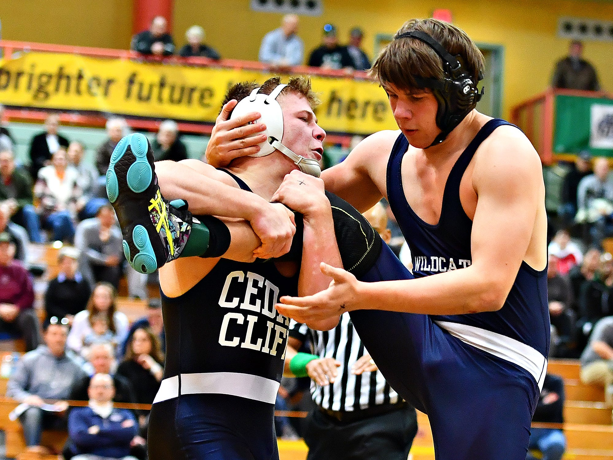 Dallastown's Andrew Smith, right, wrestles Cedar Cliff's Donovan Ball in the 195 pound weight class during District 3, Class 3A wrestling championship action at Milton Hershey High School in Hershey, Saturday, Feb. 2, 2019. Dawn J. Sagert photo