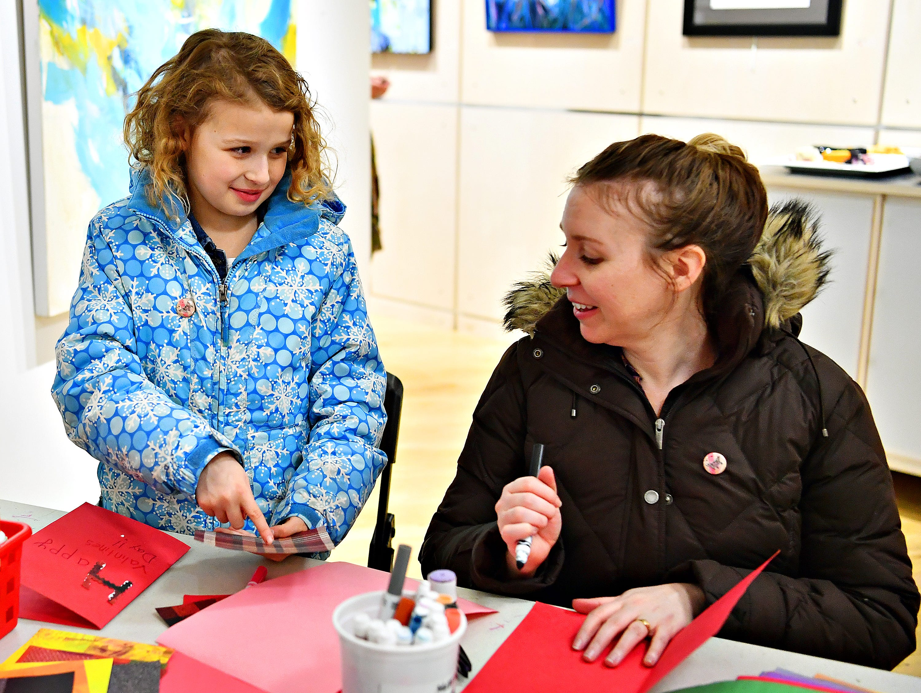 "Nora Smeltzer, 9, left, and her mother Nicole Smeltzer, of Spring Garden Township, make valentines to be given to residents at a local senior center during a First Friday Valentine art activity at Creative York in York City, Friday, Feb. 1, 2019. Each person making a Valentine for seniors would receive a 10,000 Acts of Kindness ""Kindness Coin"" which will guarantee the recipient a seat at the table during the Celebration of York's Unity at Penn Park on June 30. Dawn J. Sagert photo"