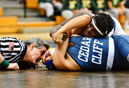 Dallastown's Jamal Brandon wrestles Cedar Cliff's Jayvon Godineaux in the 220 pound weight class during District 3, Class 3A wrestling championship action at Milton Hershey High School in Hershey, Saturday, Feb. 2, 2019. Brandon would win with a pin at 2:43. Dawn J. Sagert photo