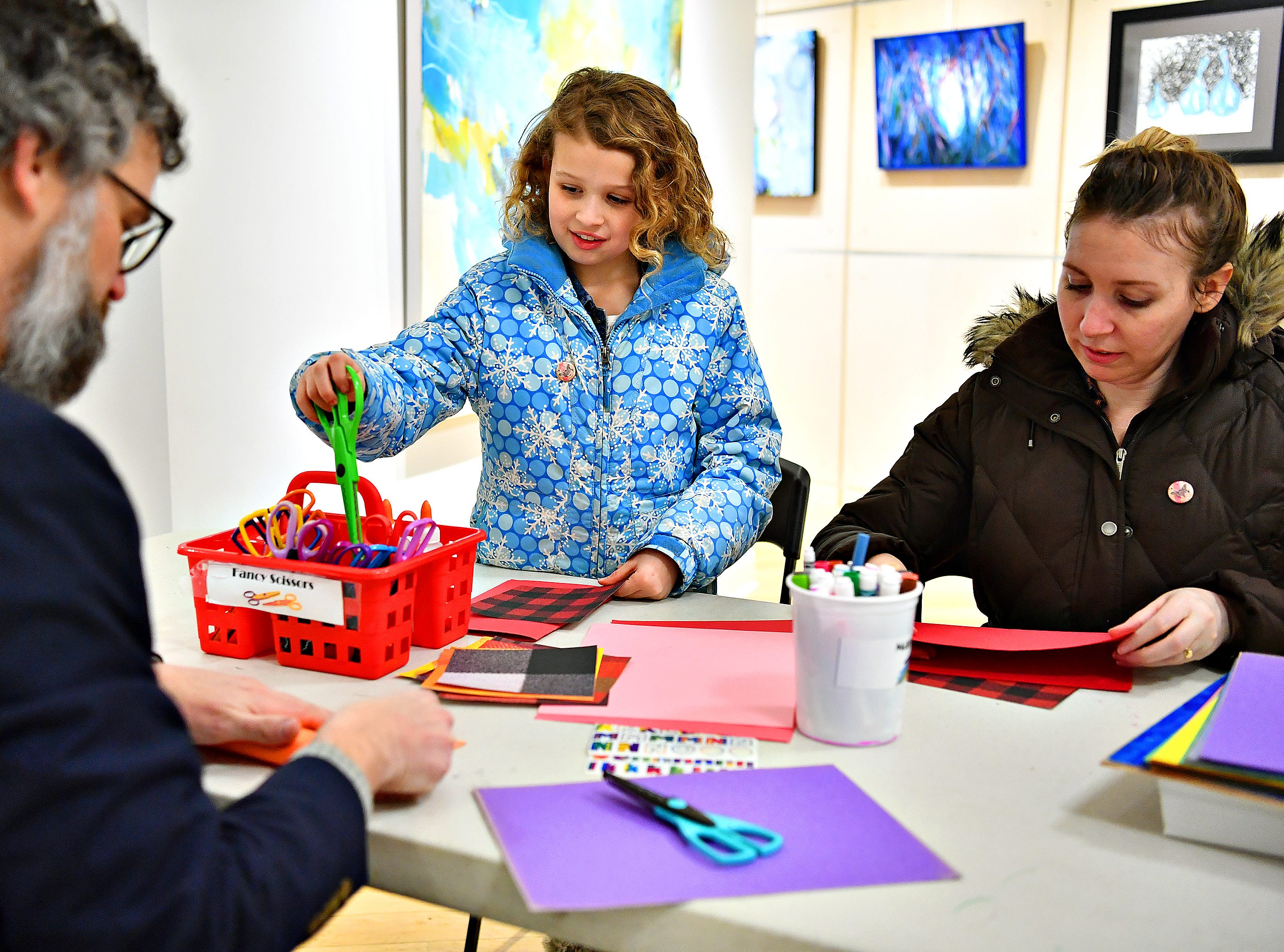 "From left, Mike Smeltzer, Nora Smeltzer, 9, and Nicole Smeltzer, all of Spring Garden Township, make valentines to be given to residents at a local senior center during a First Friday Valentine art activity at Creative York in York City, Friday, Feb. 1, 2019. Each person making a Valentine for seniors would receive a 10,000 Acts of Kindness ""Kindness Coin"" which will guarantee the recipient a seat at the table during the Celebration of York's Unity at Penn Park on June 30. Dawn J. Sagert photo"