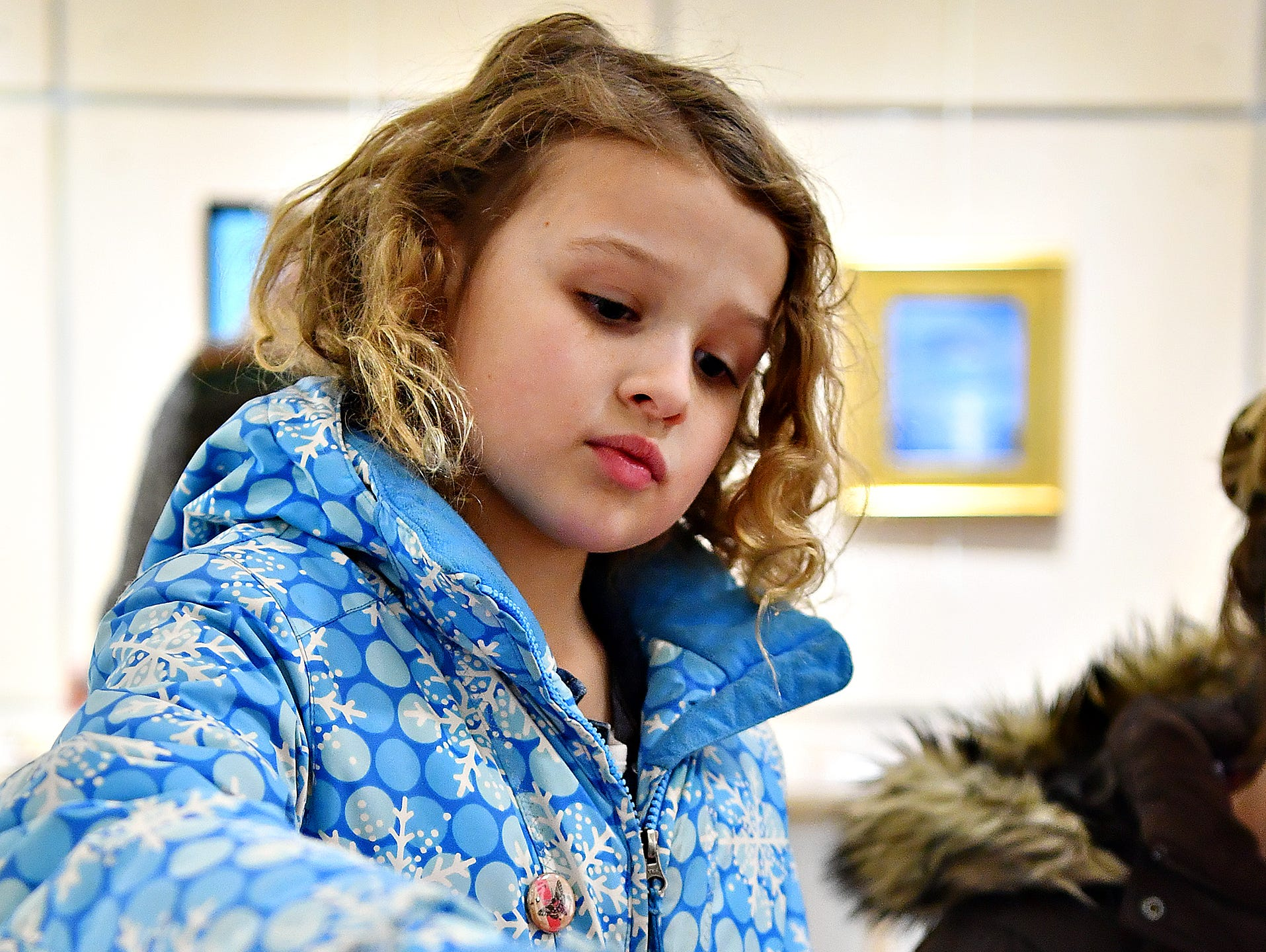 "Nora Smeltzer, 9, of Spring Garden Township, makes a valentine to be given to a resident at a local senior center during a First Friday Valentine art activity at Creative York in York City, Friday, Feb. 1, 2019. Each person making a Valentine for seniors would receive a 10,000 Acts of Kindness ""Kindness Coin"" which will guarantee the recipient a seat at the table during the Celebration of York's Unity at Penn Park on June 30. Dawn J. Sagert photo"